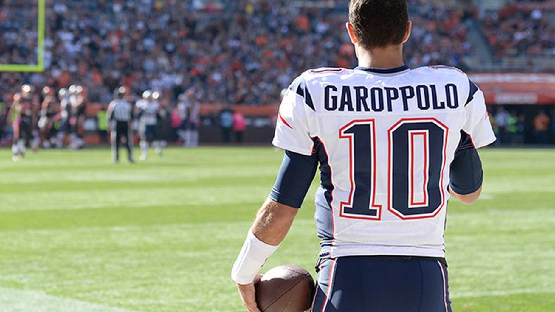 New England Patriots quaterback Jimmy Garoppolo (10) watches the action during the 2016 NFL week 5 regular season football game against the Cleveland Browns on Sunday, Oct. 9, 2016 in Cleveland. The Patriots defeated the Browns 33-13. (Jim Mahoney via AP)