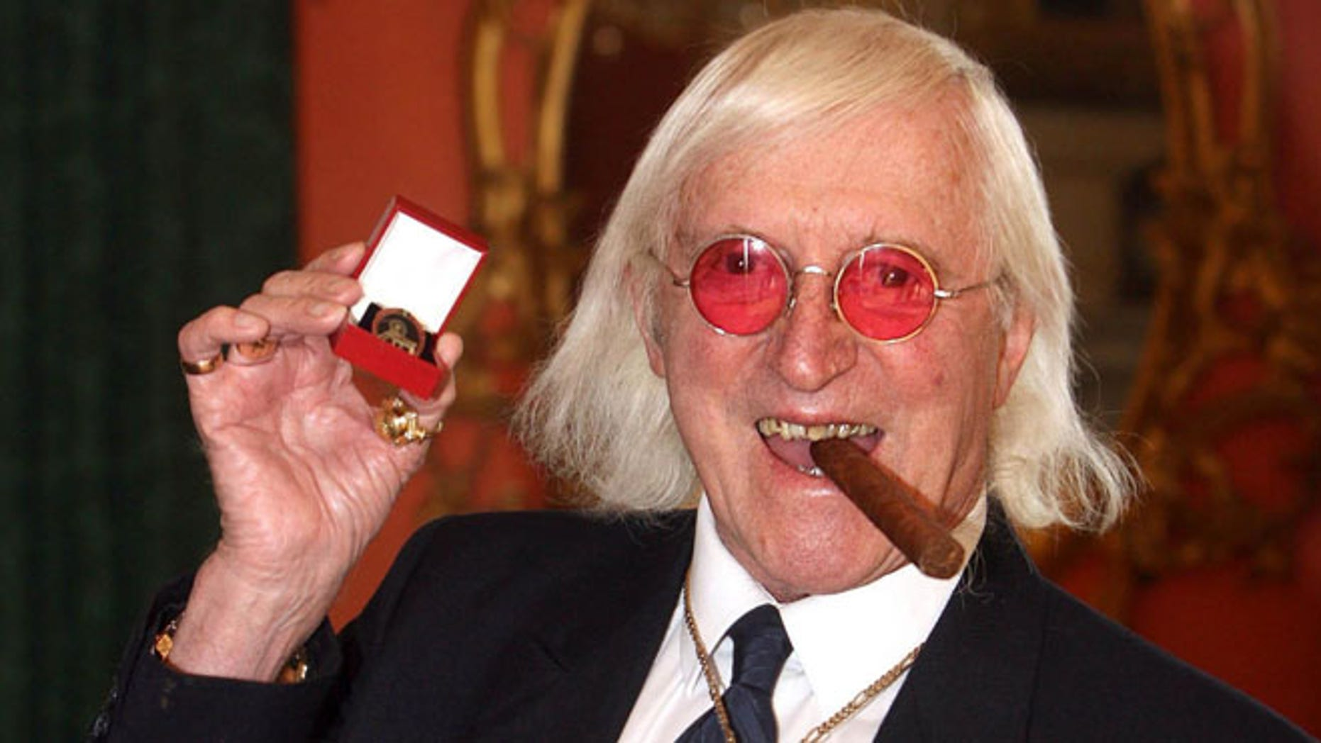 March 25, 2008. Jimmy Savile showing a medal in London.