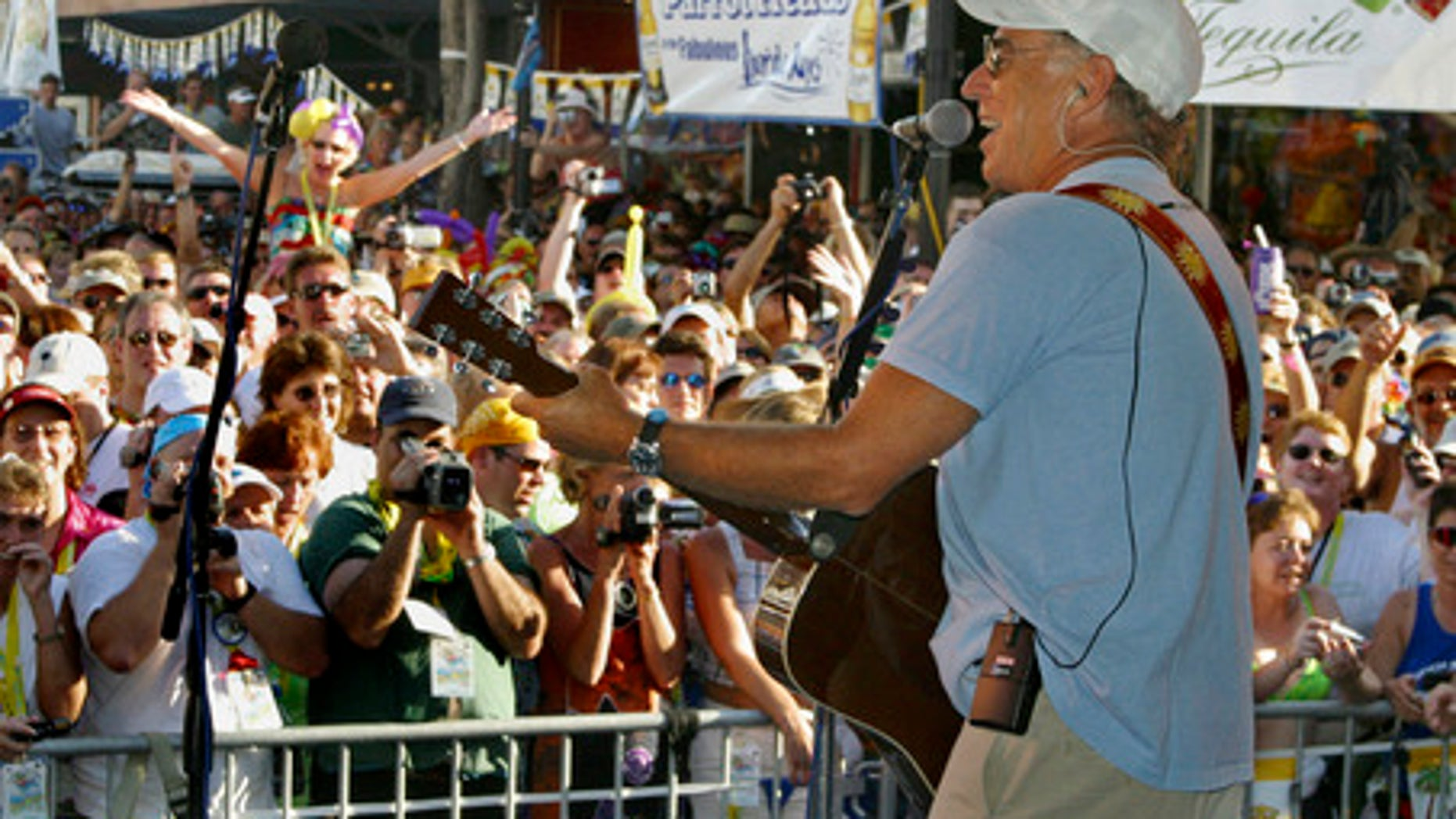 Singer Jimmy Buffett makes a surprise appearance at the annual Parrot Heads in Paradise convention in Key West, Fla.,  Friday Nov. 1, 2002. More than 3,000 of the singer's fans have gathered in Key West through Sunday, Nov. 3. There are now almost 160 Parrot Head chapters in the U.S., Australia and Canada with more than 18,000 total members. (AP Photo/Florida Keys News Bureau, Roberto Rodriguez)