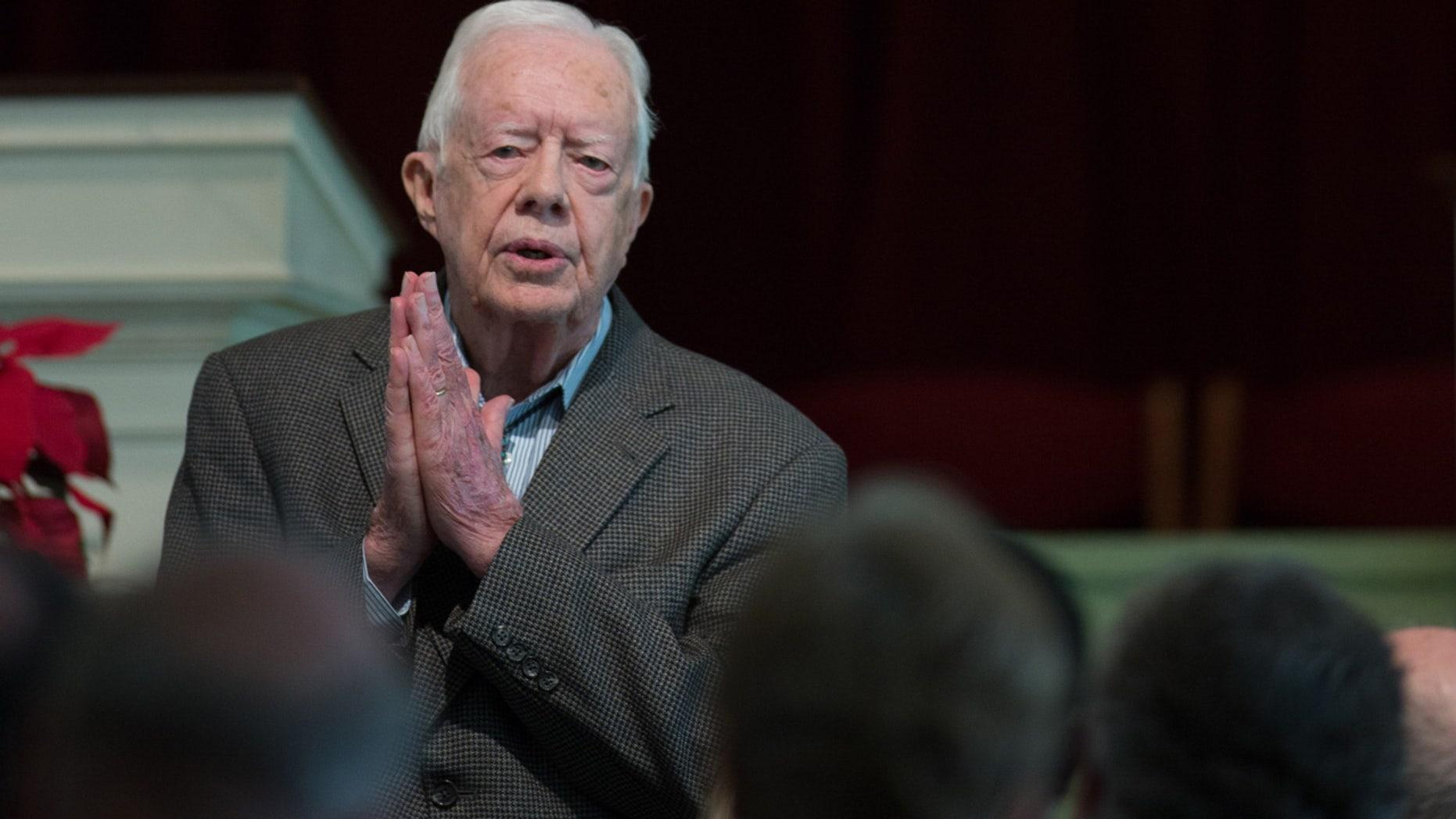Former President Jimmy Carter teaches during Sunday School class at Maranatha Baptist Church in his hometown, Sunday, Dec. 13, 2015, in Plains, Ga. (AP Photo/Branden Camp)