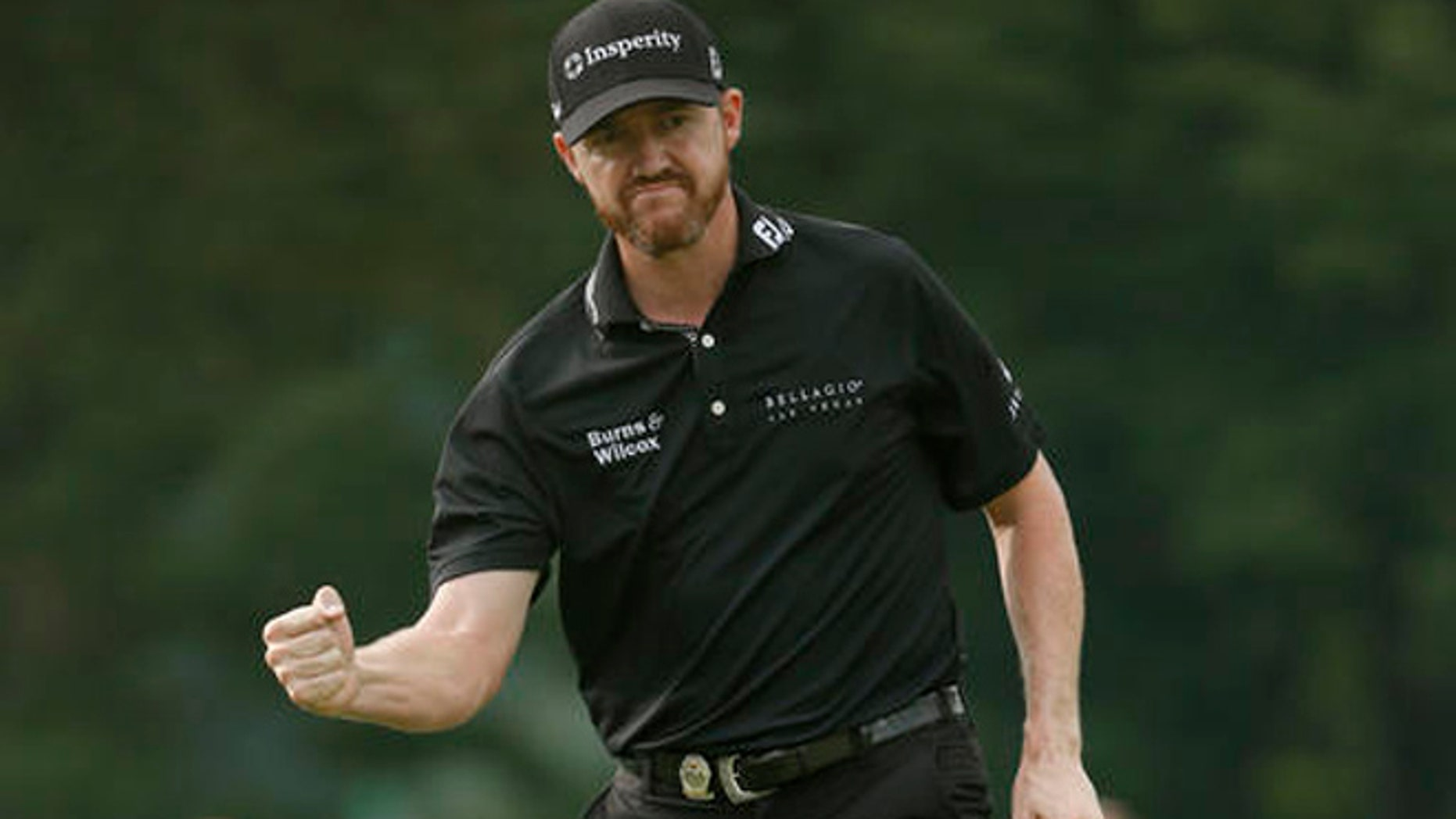 Jimmy Walker reacts to his birdie putt on the 11th hole during the final round of the PGA Championship golf tournament at Baltusrol Golf Club in Springfield, N.J., Sunday, July 31, 2016.