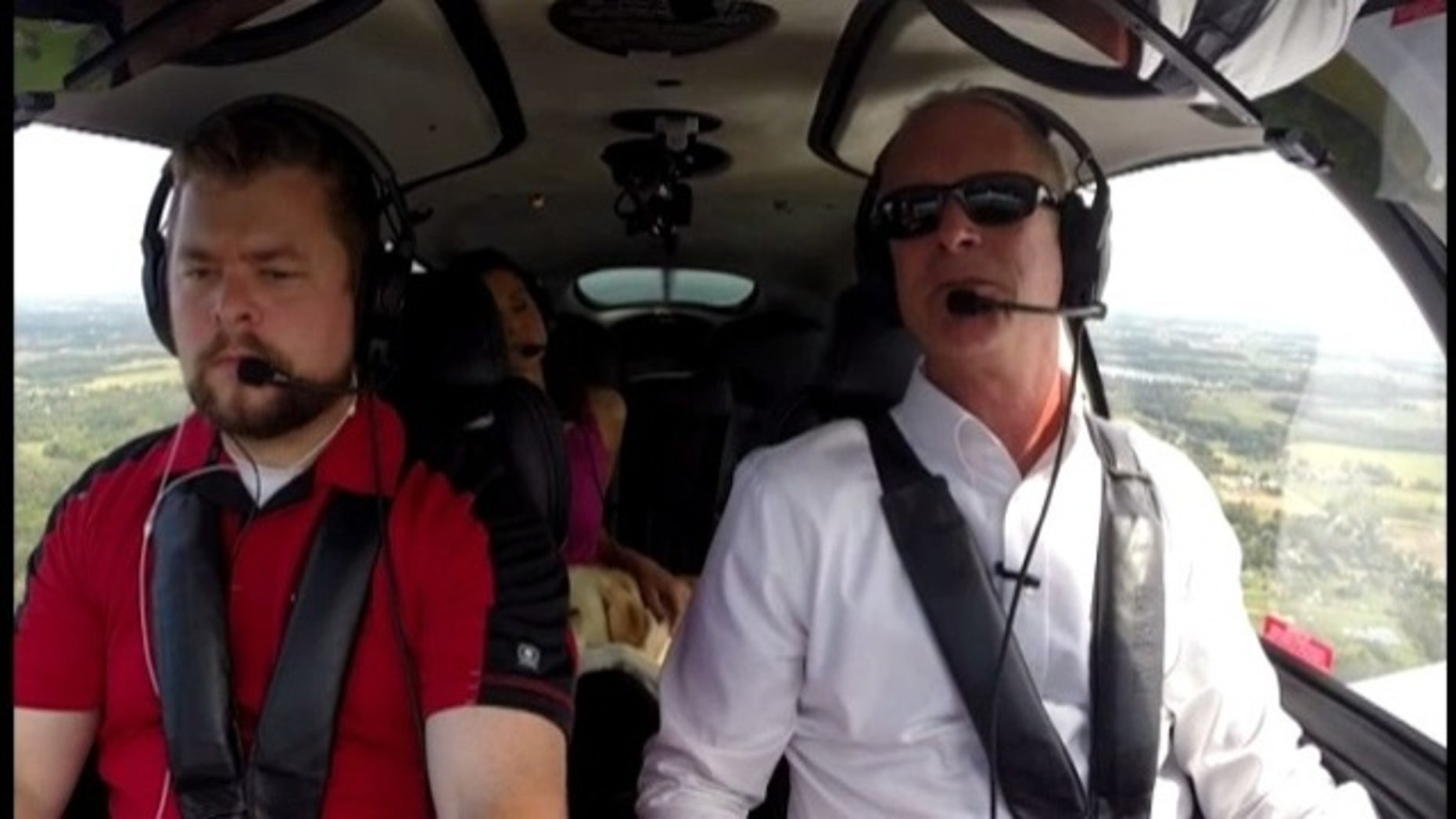 Jim Platzer, right, flies planes despite losing 95 percent of his vision.
