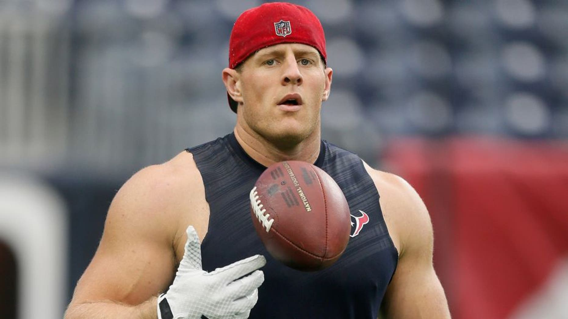 HOUSTON, TX - AUGUST 15: J.J. Watt #99 of the Houston Texans warms up before the Houston Texans play the San Francisco 49ers in a preseason football game at Reliant Arena at Reliant Park on August 15, 2015 in Houston, Texas. Houston won 23-10. (Photo by Bob Levey/Getty Images)