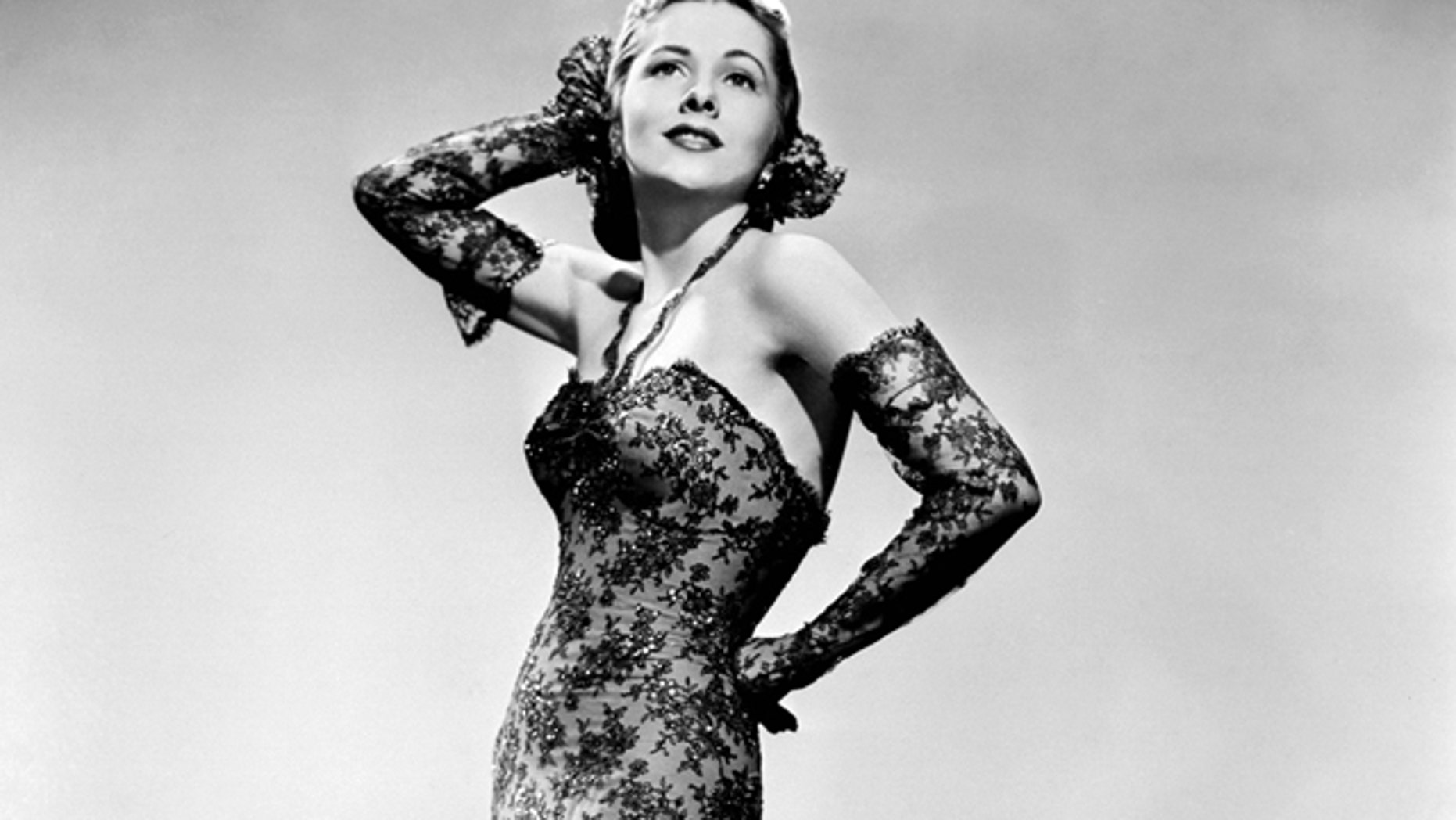 File- This April 1945 file photo shows actress Joan Fontaine wearing a gown.