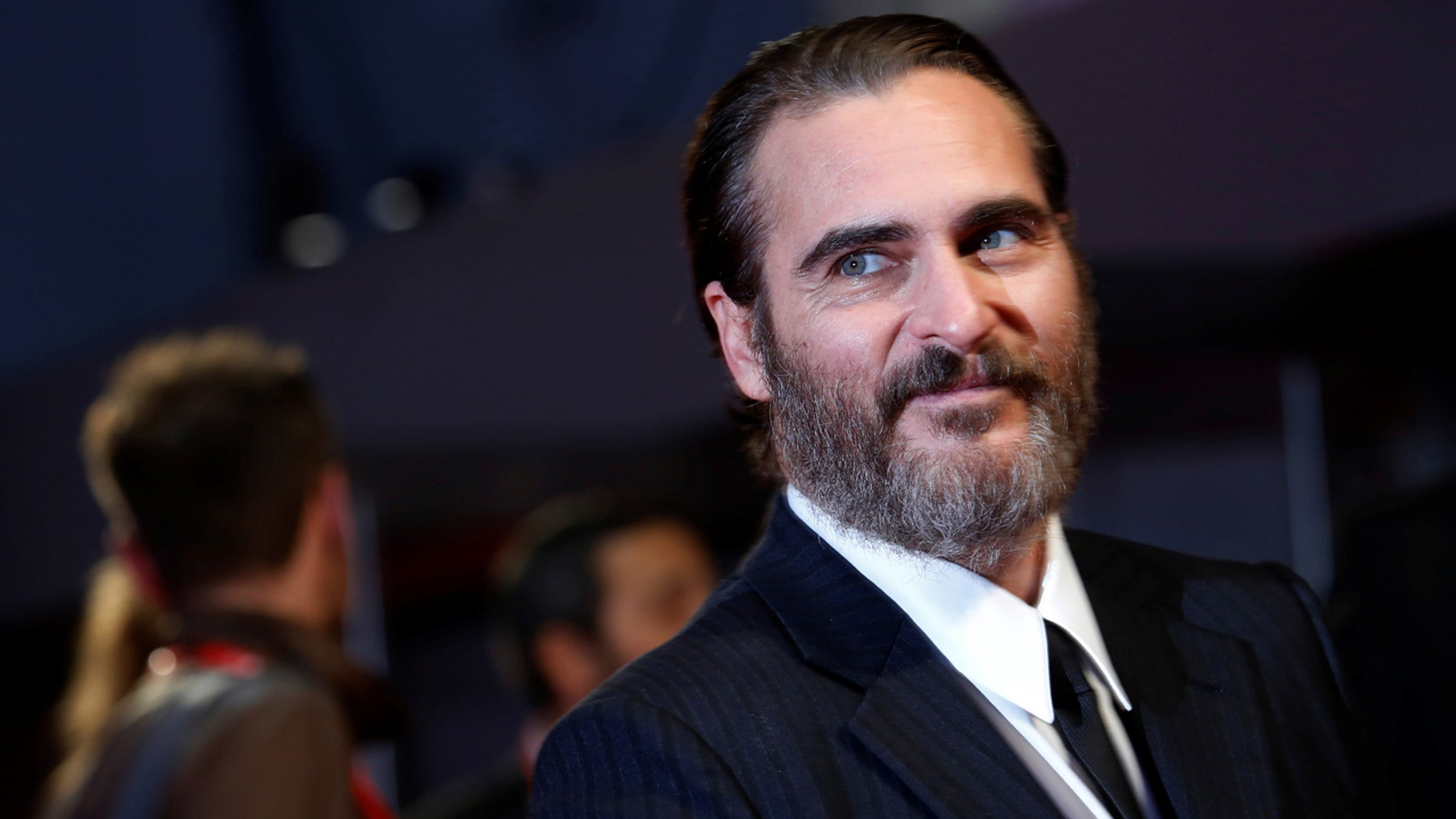 "Joaquin Phoenix arrives for UK premiere of ""You were never really there"" during the British Film Institute (BFI) London Film Festival at Leicester Square in London, Britain, October 14, 2017.  REUTERS/Luke MacGregor - RC18AFFEB6F0"