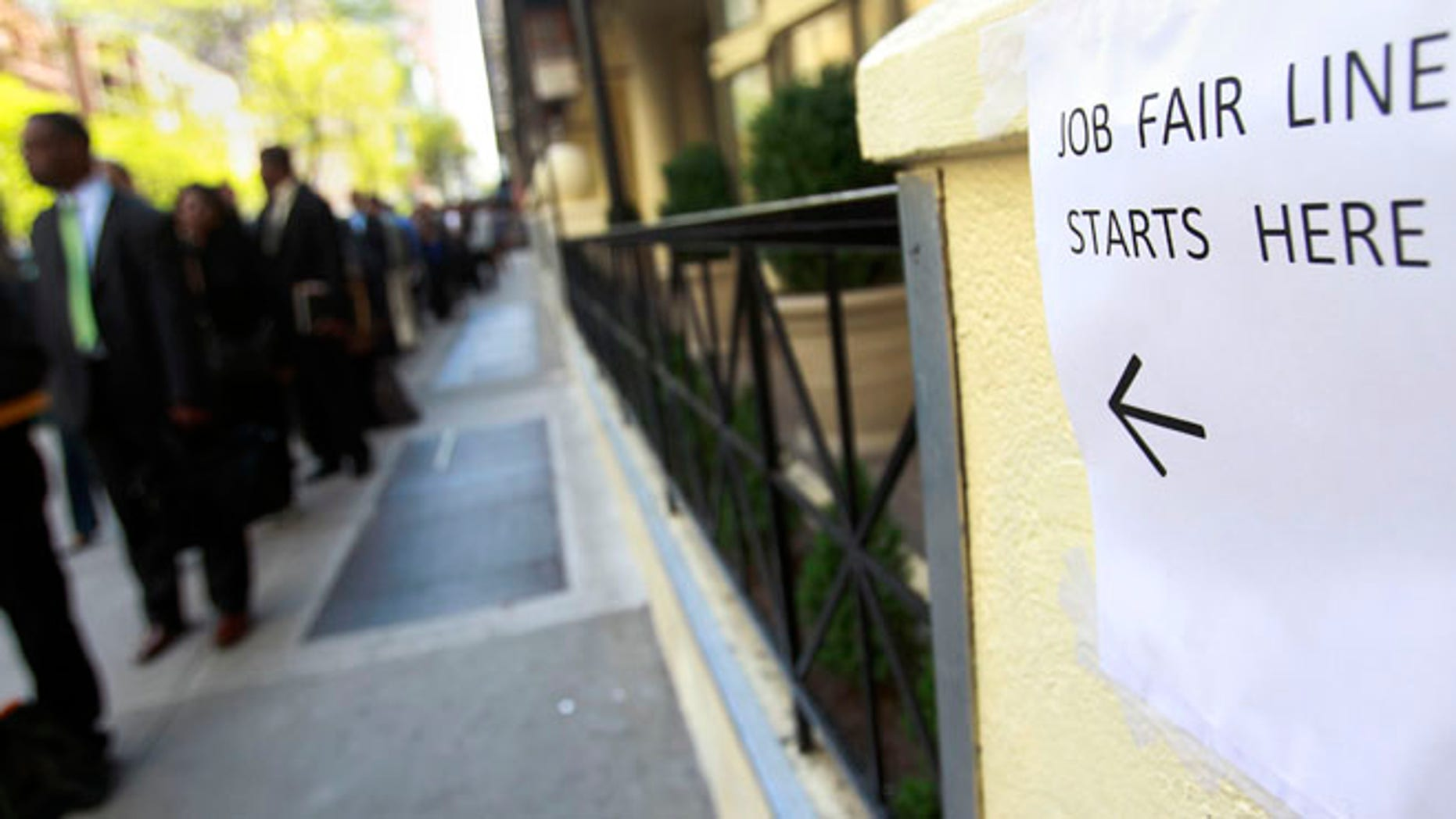 April 18, 2012: People wait in line to enter a job fair in New York.