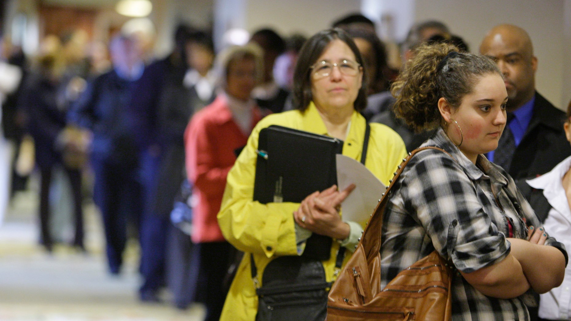 May 3, 2011: Samantha Ferrara, 19, waits in line for a job fair to open, in Independence, Ohio.