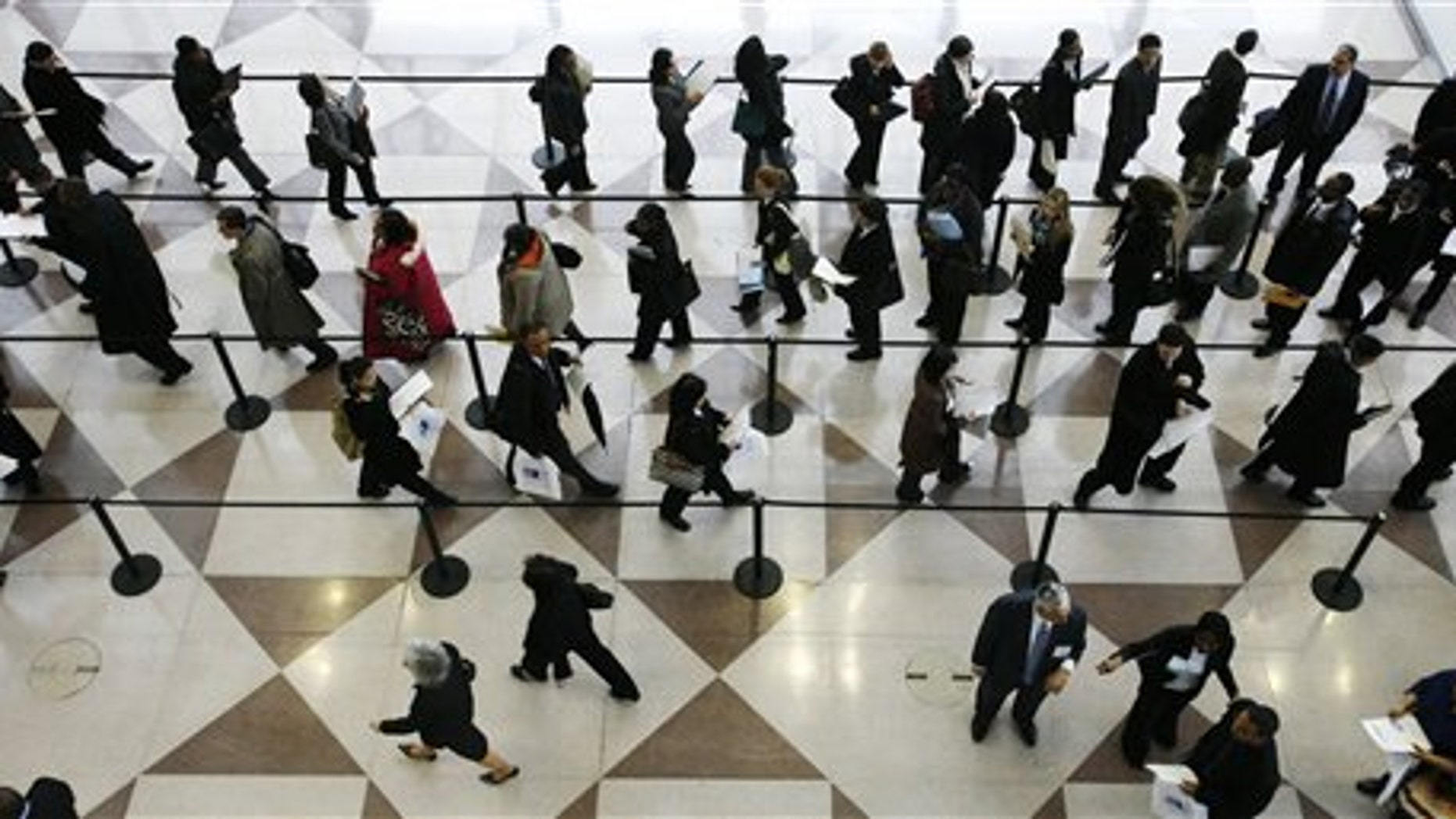 In this March 20, 2009, file photo, a line of job applicants is shown at the CUNY Big Apple Job Fair in New York.