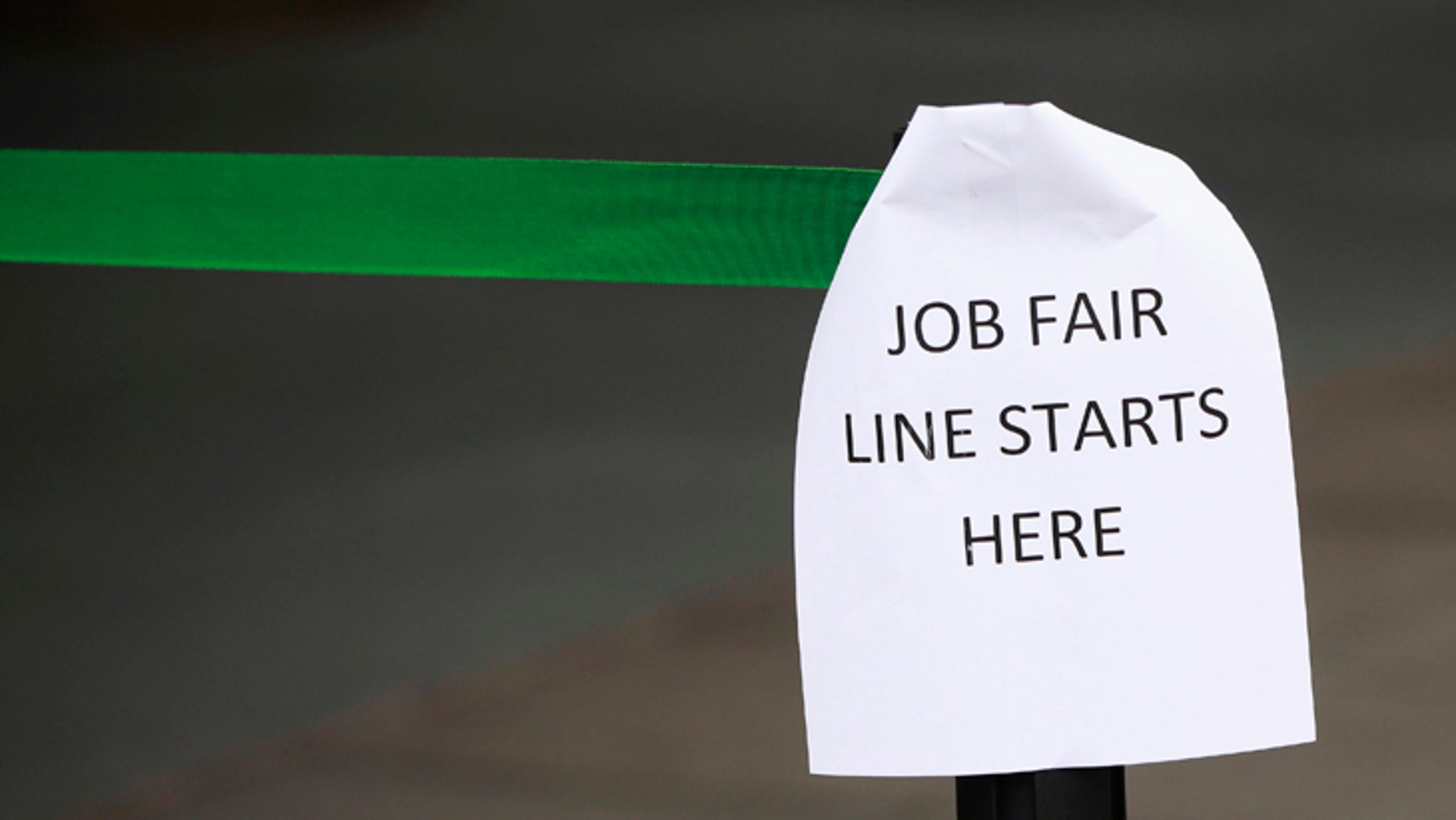 File photo - A sign marks the entrance to a job fair in New York October 24, 2011. (REUTERS/Shannon Stapleton)