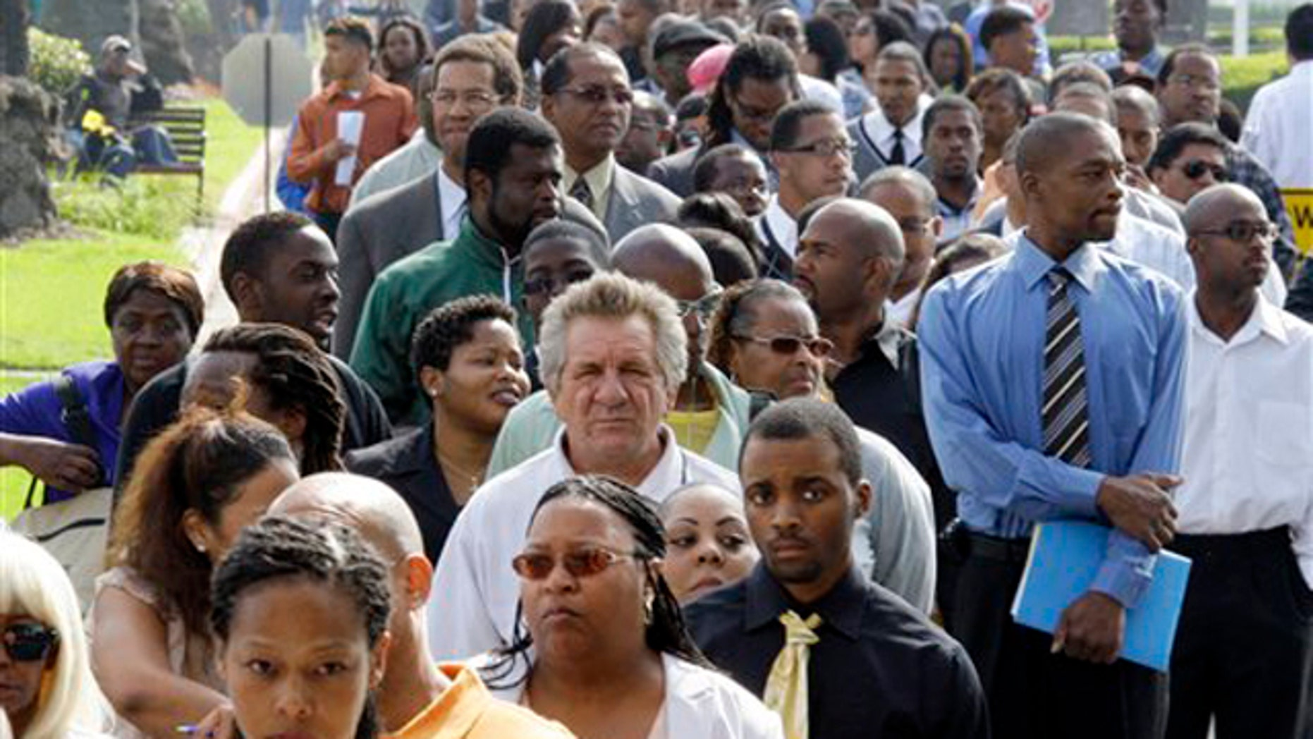 In this Aug. 31 photo, crowds of job-seekers wait to enter a job fair at Crenshaw Christian Center in South Los Angeles.