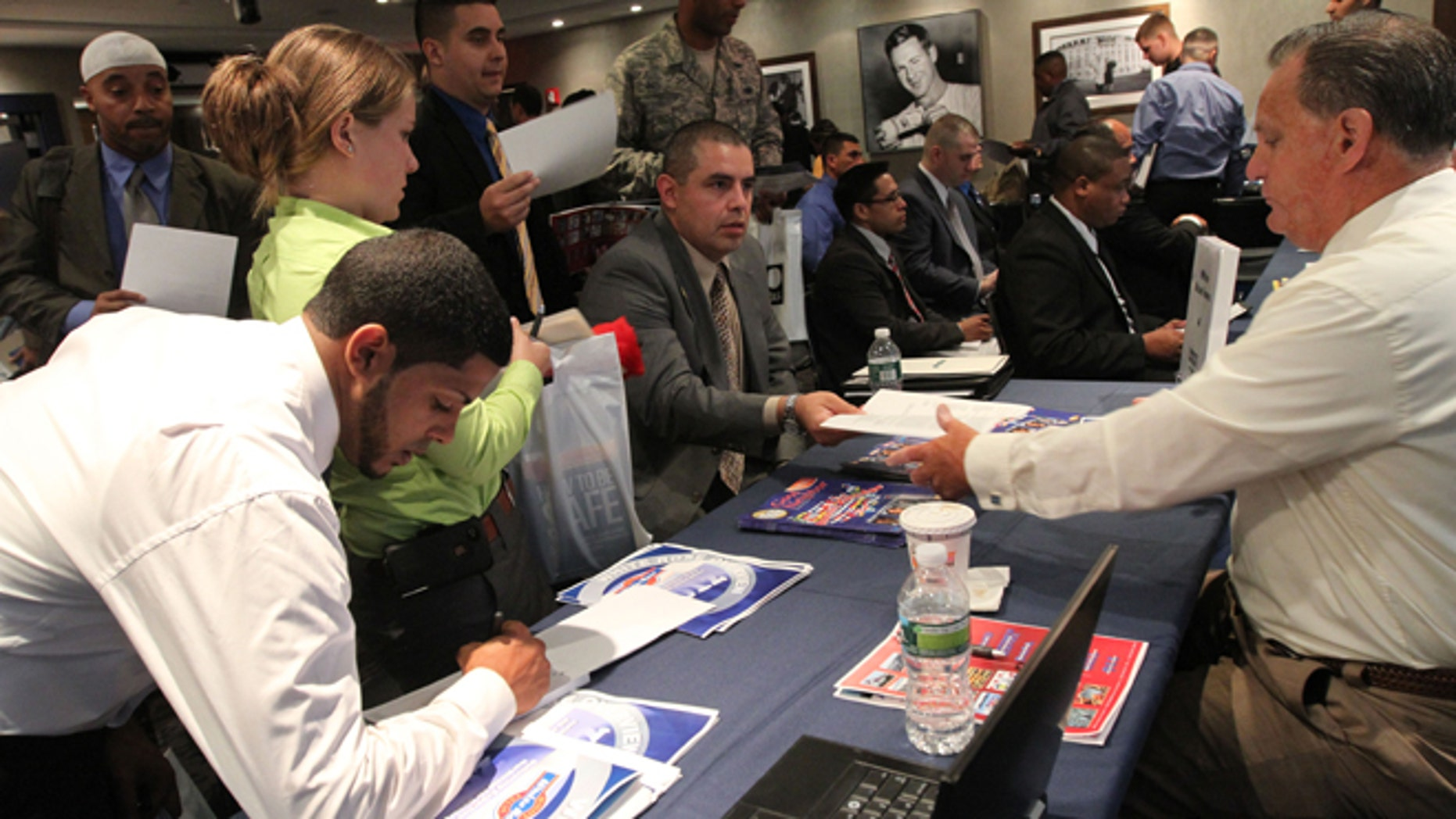 Sept. 28, 2012: Job-seekers hand in resumes during a job fair at Yankee Stadium in the Bronx.