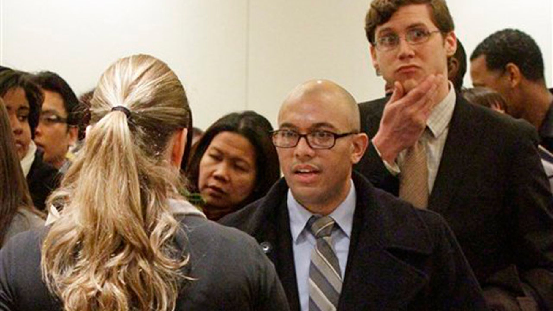 Jan. 25, 2012: Job seekers attend a job fair held by JobEXPO in New York.