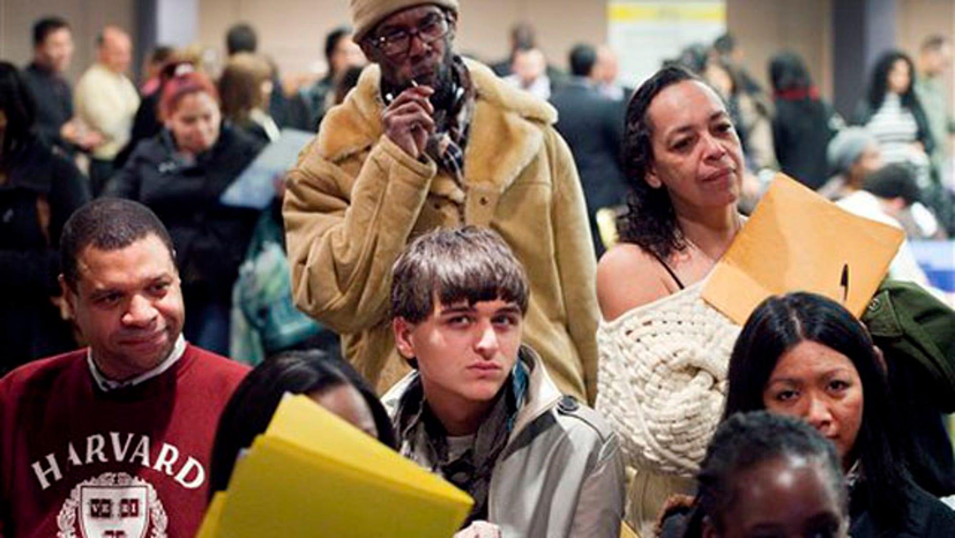 Feb. 22, 2012: Job seekers attend a National Career Fair in New York.
