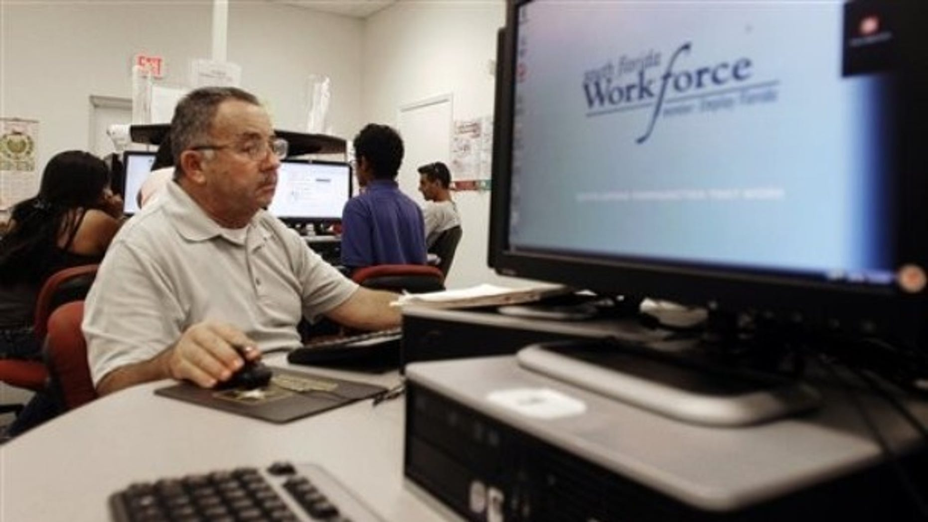In this Sept. 2, 2010 photo, job seeker Jose Jaramillo , of Hialeah, works the computer as he looks for employment at the South Florida Workforce office in Hialeah Gardens, Fla. (AP)