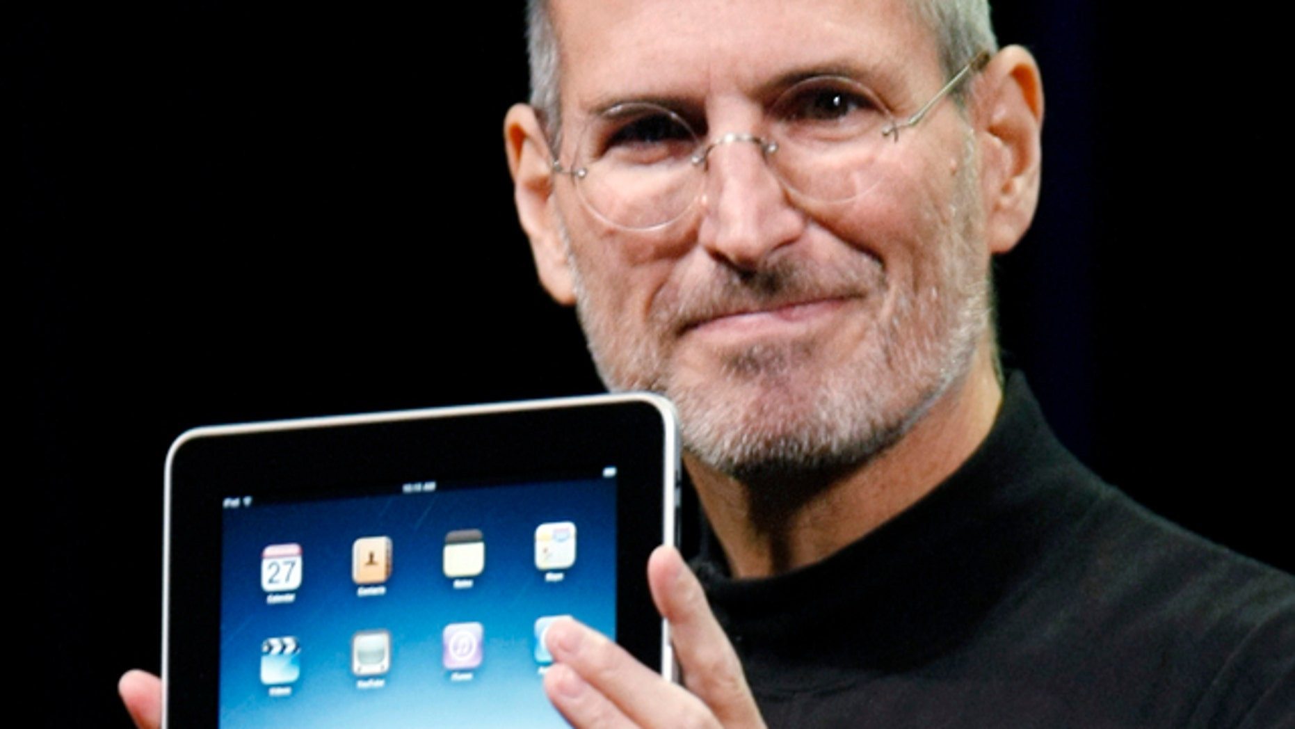 Jan. 27, 2010: Apple CEO Steve Jobs holds the new iPad during a product announcement in San Francisco.