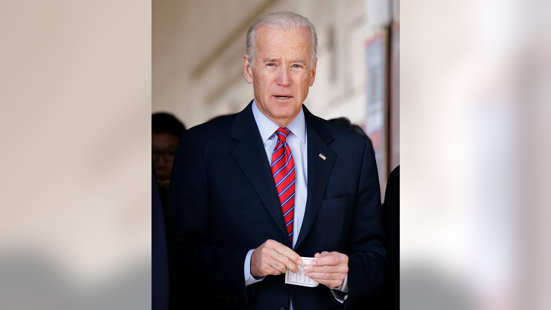 U.S. Vice President Joe Biden leaves after laying a wreath in front of the list of names of U.S. soldiers who died during the 1950-53 Korean War, at the Korean War Memorial Museum in Seoul, Dec. 7, 2013.