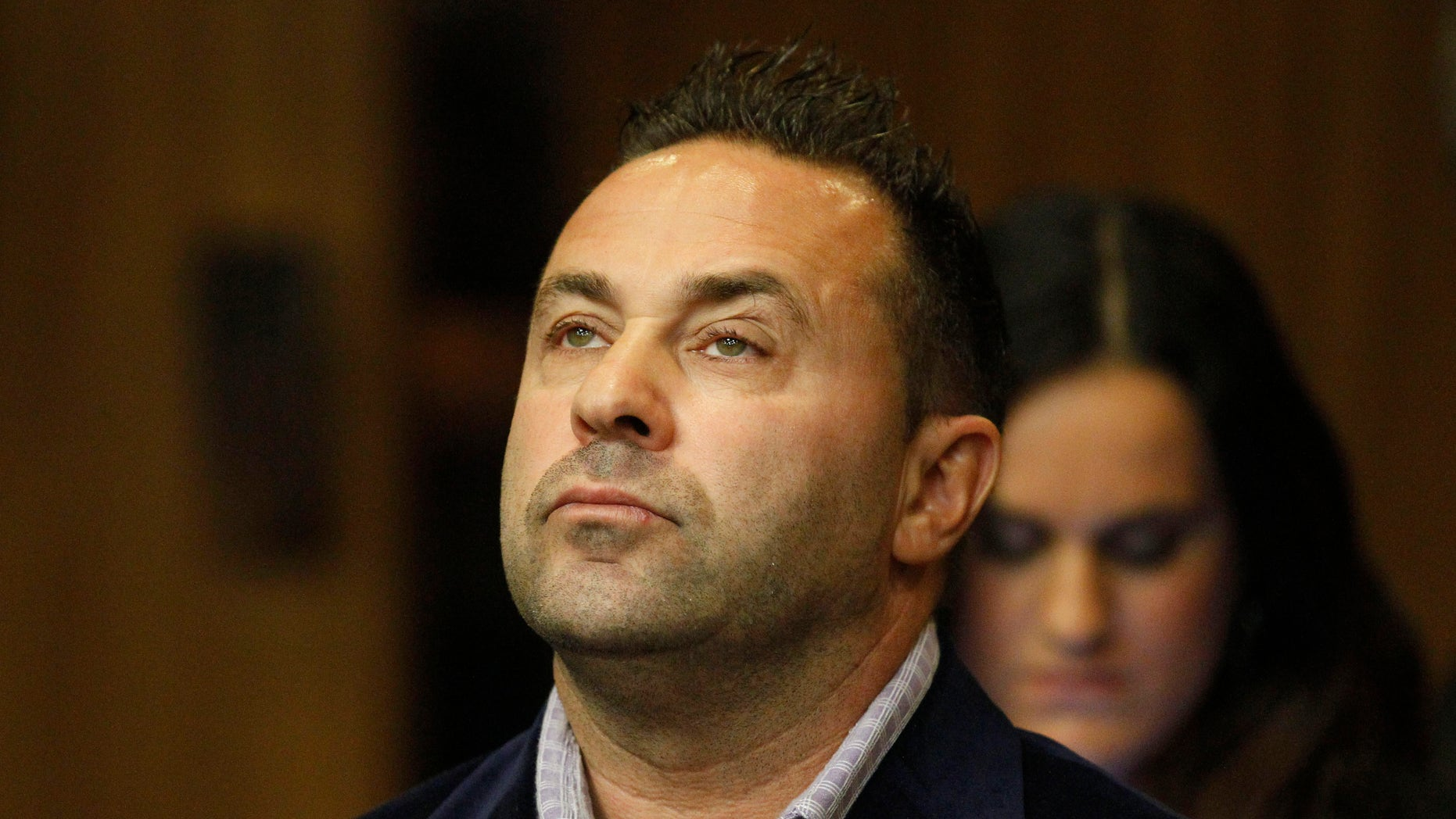 """October 15, 2014. Giuseppe """"Joe"""" Giudice, from the television show """"Real Housewives of New Jersey"""", stands during a hearing in the Passaic County Courthouse, in Paterson, N.J. Giudice accepted a plea deal Wednesday after initially telling the judge through his attorney that he would go to trial on charges of unlawful use of an ID and impersonation. Under the deal, Giudice will be sentenced to 18 months in prison, to be served concurrently with his 41-month federal sentence."""