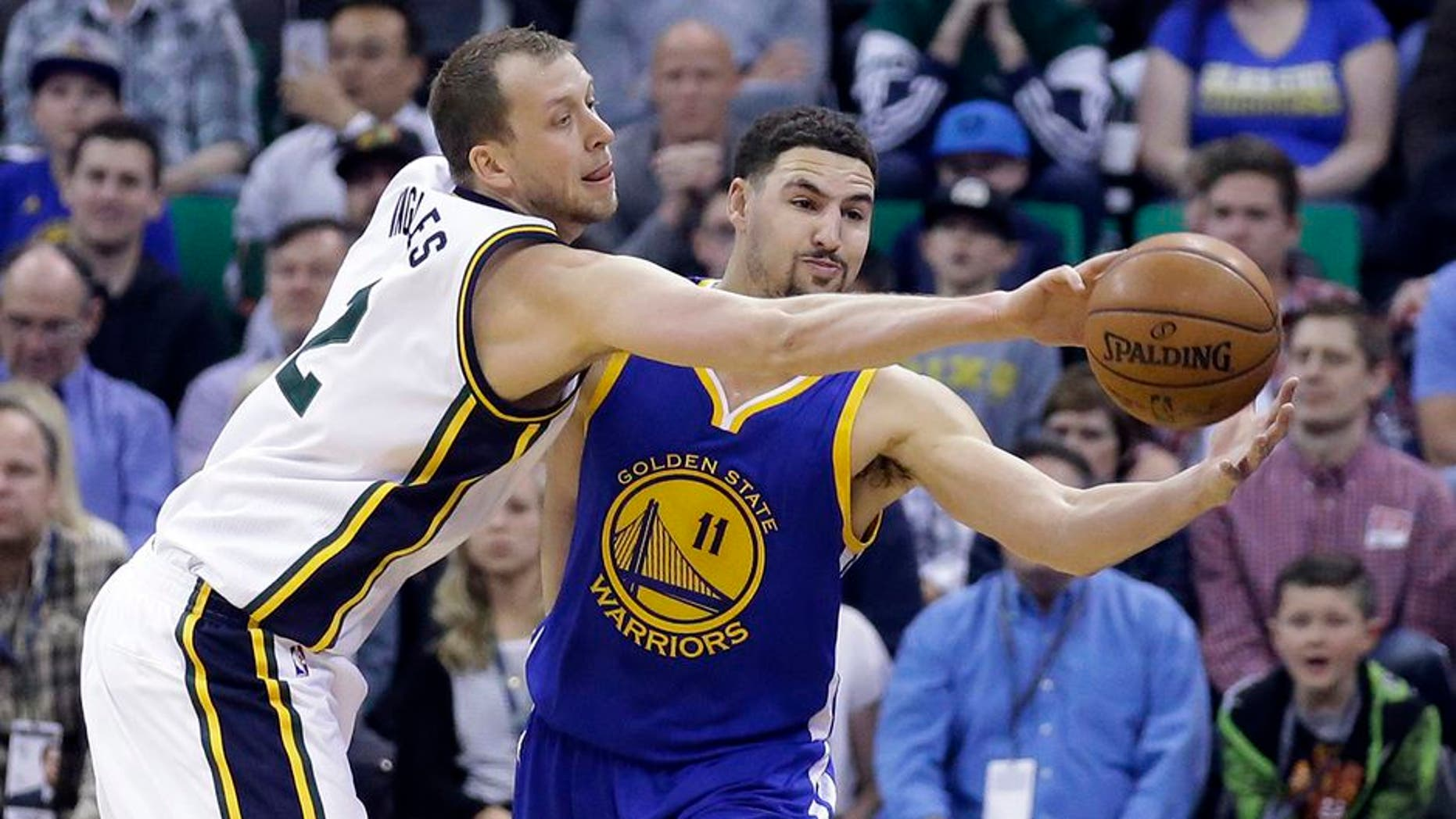 Utah Jazz forward Joe Ingles (2) defends against Golden State Warriors guard Klay Thompson (11) during the second quarter of an NBA basketball game Wednesday, March 30, 2016, in Salt Lake City. (AP Photo/Rick Bowmer)