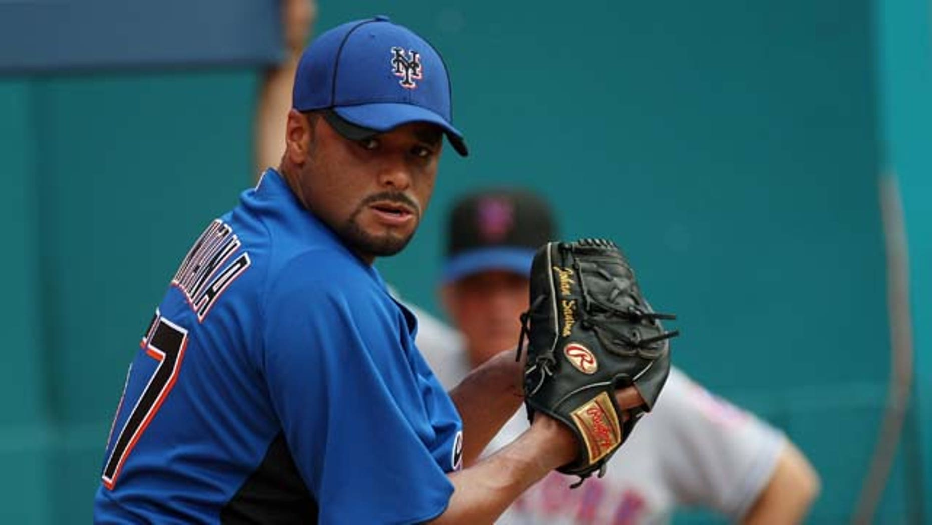 July 24, 2011: Johan Santana #57 of the New York Mets pitches in the bullpen as Manager Terry Collins #10 looks on during a throwing session before a game against the Florida Marlins at Sun Life Stadium in Miami Gardens, Fla.