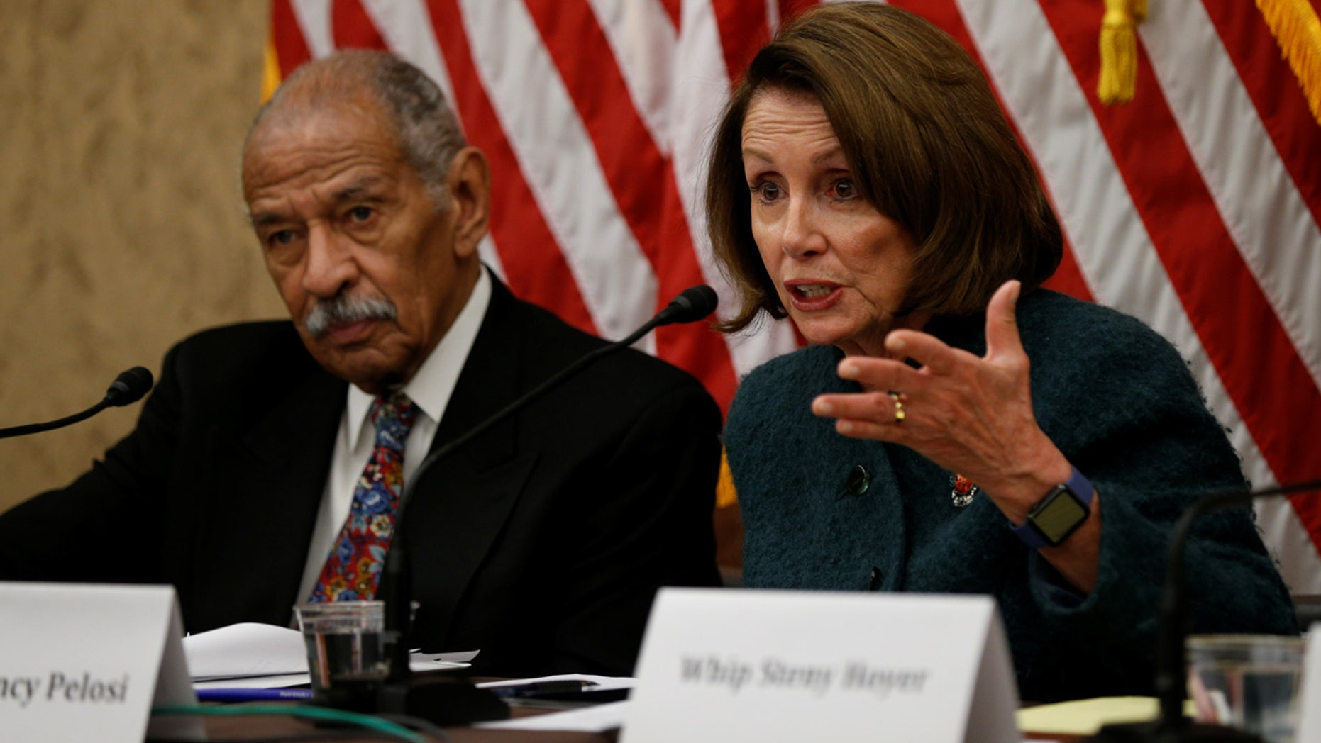 House Minority leader Nancy Pelosi and Rep. John Conyers take part in a discussion panel on President Trump's Muslim and refugee ban in the U.S. Capitol in Washington, U.S., February 2, 2017.