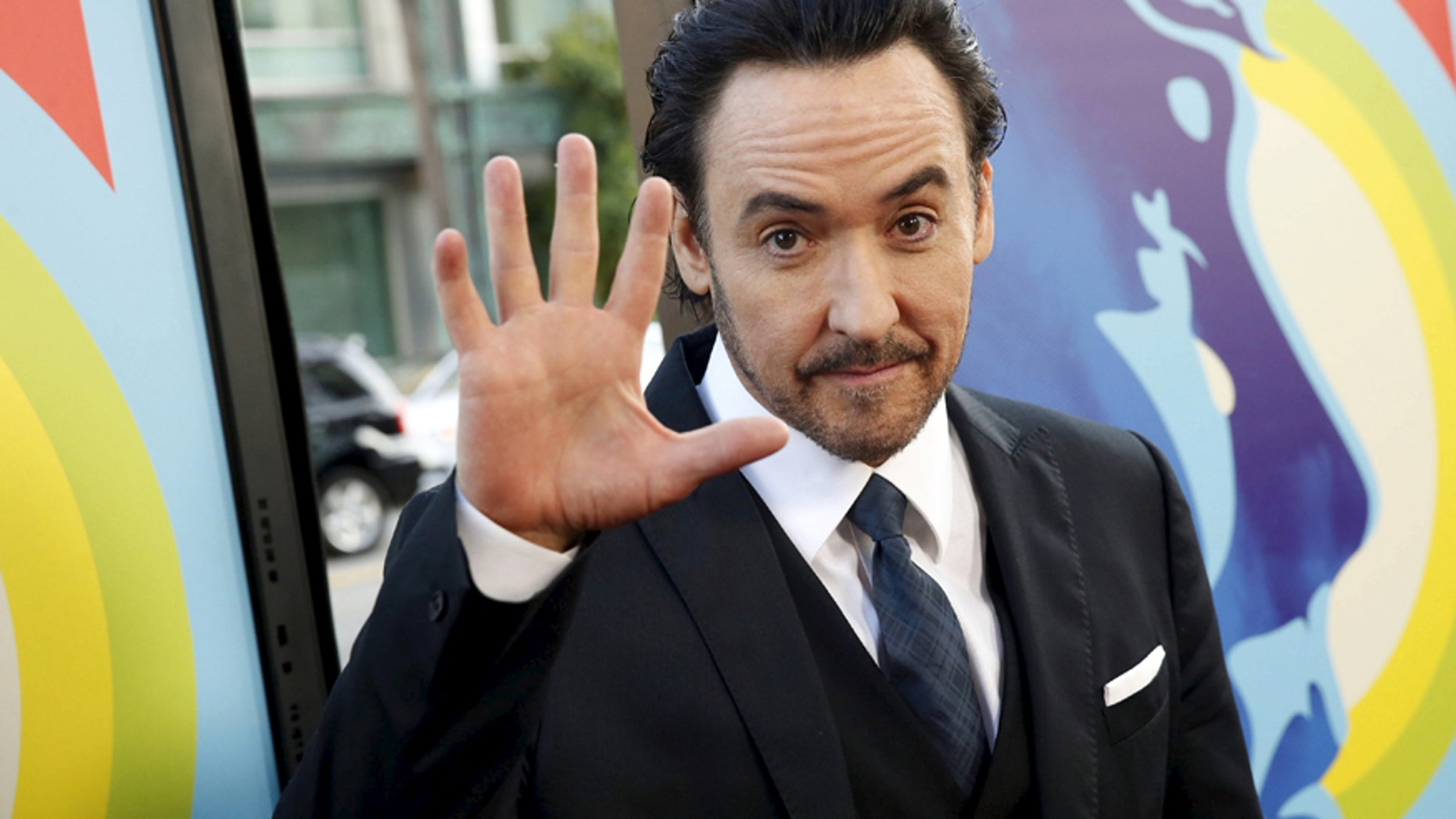 """Actor John Cusack arrives at the premiere of the movie """"Love & Mercy"""" at the Samuel Goldwyn Theater in Beverly Hills, California June 2, 2015."""
