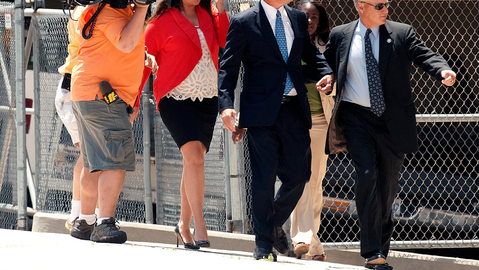 John Edwards, center, enters the Federal Building in downtown Winston-Salem, N.C. on Friday, June 3, 2011. (AP)