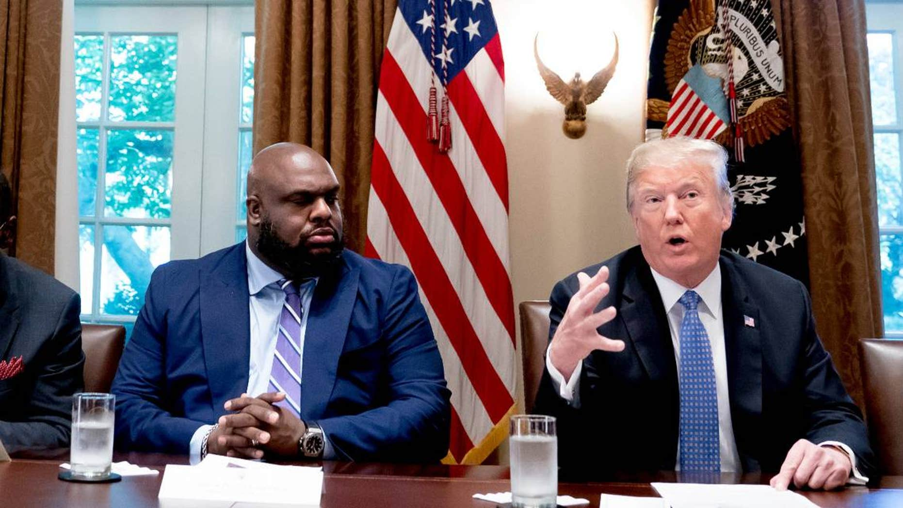 The Rev. John Gray, pastor of Relentless Church in Greenville, S.C., and other religious leaders meet with President Trump at the White House, Aug. 1, 2018.