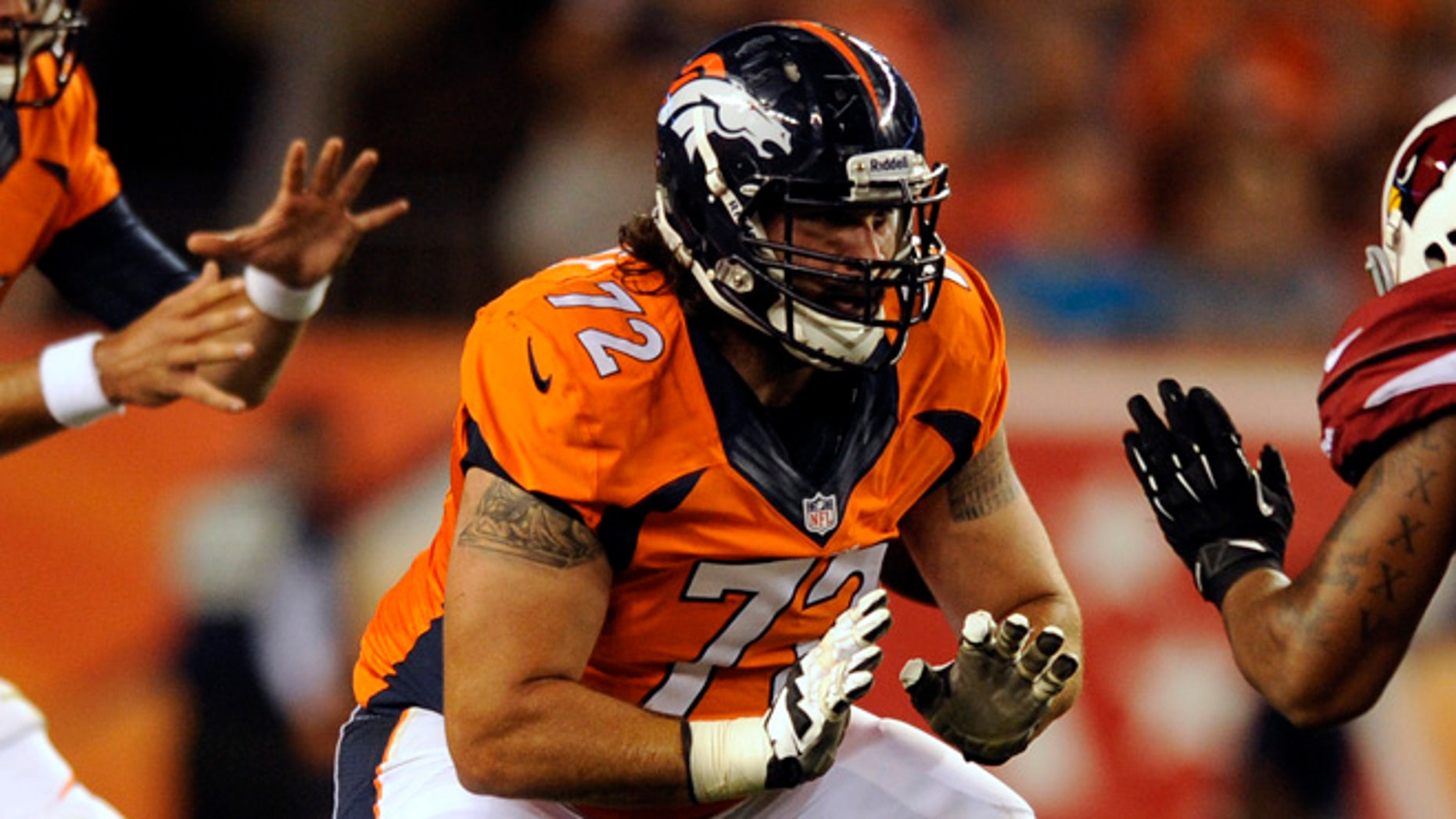 Aug. 29, 2013: Denver Broncos guard John Moffitt plays against the Arizona Cardinals during a pre-season NFL football game in Denver. Moffitt says he quit the NFL this week not because he was unhappy with a lack of playing time in Denver but because he'd lost his love for the game and was tired of risking his health.