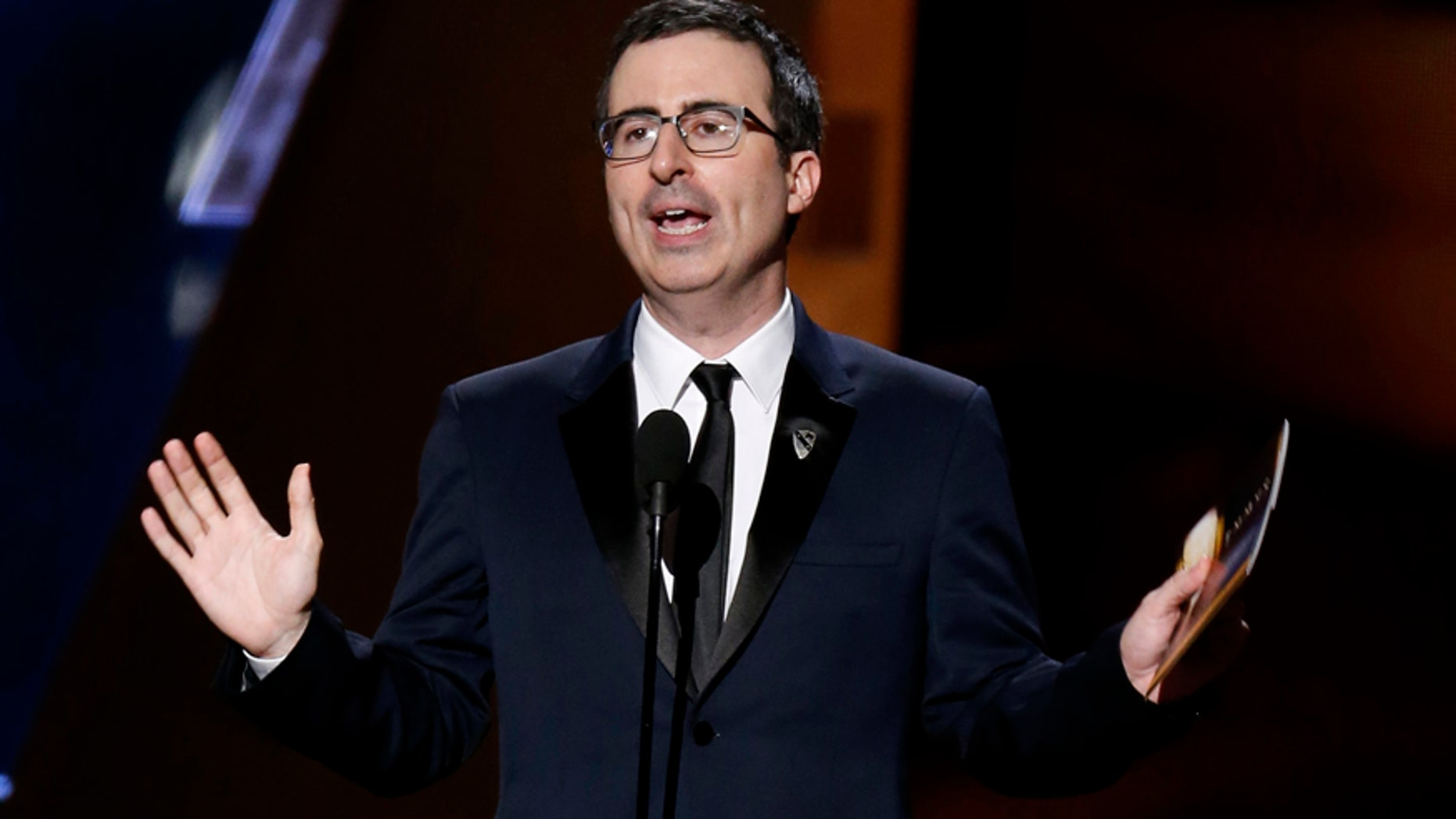 John Oliver tackled the Dustin Hoffman assault rumors during a live Q&A, but did not receive answers. Here Oliver presents an award at the 67th Annual  Emmy Awards in Los Angeles, September 2015