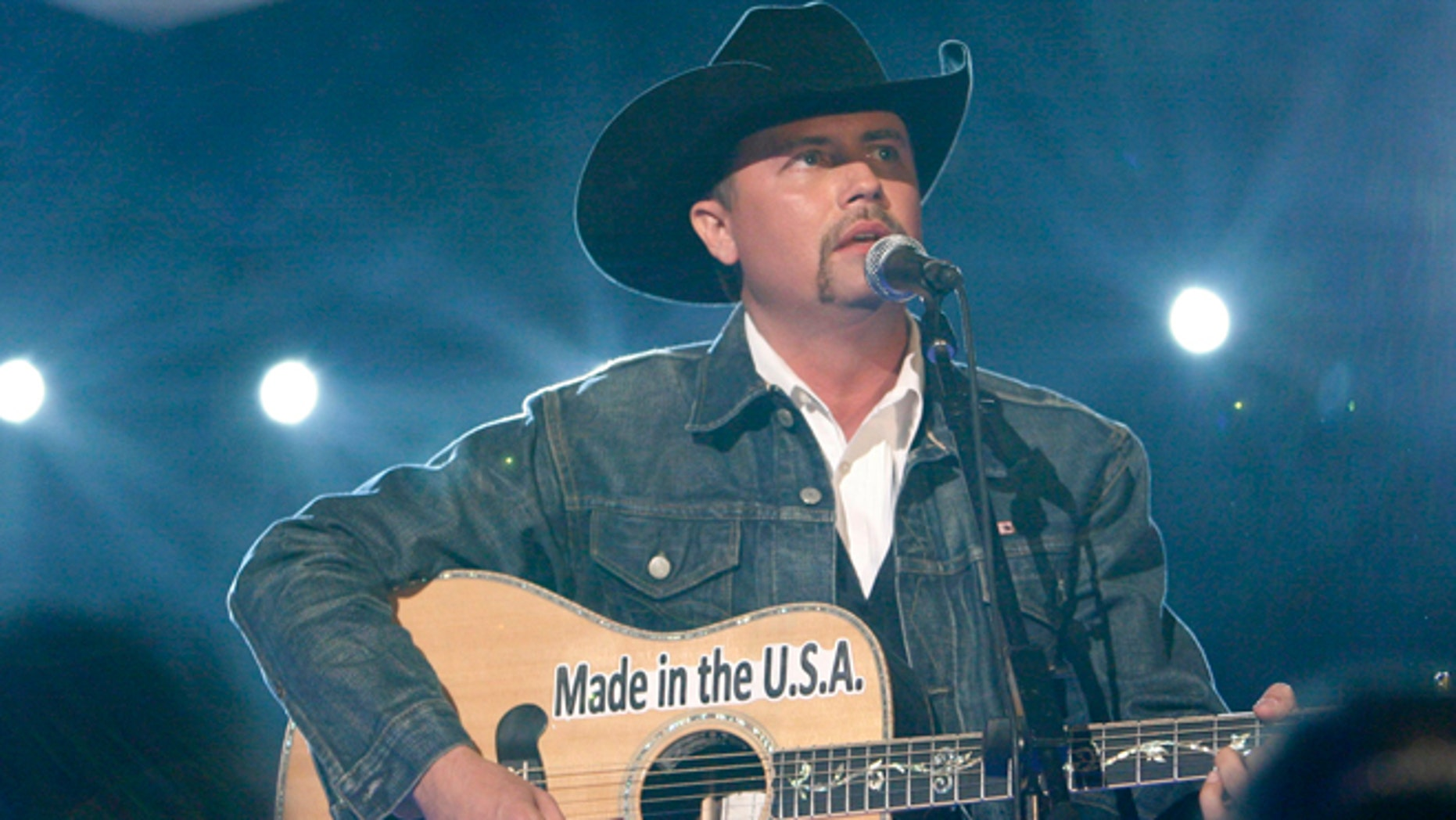 "John Rich sings ""Shuttin' Detroit Down"" at the 44th Annual Academy of Country Music Awards in Las Vegas April 5, 2009.     REUTERS/Mario Anzuoni (UNITED STATES ENTERTAINMENT) - RTXDONL"