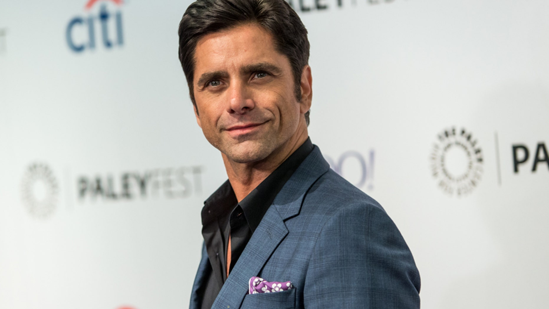 In this Sept. 15, 2015 file photo, John Stamos attends the at 2015 PaleyFest Fall TV Previews at The Paley Center for Media in Beverly Hills, Calif.