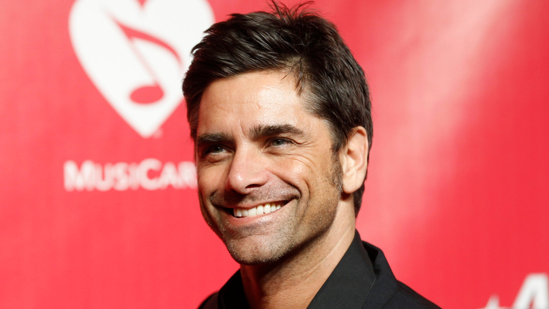 Feb 10, 2012. Actor and musician John Stamos poses at the 2012 MusiCares Person of the Year tribute honoring Paul McCartney in Los Angeles.