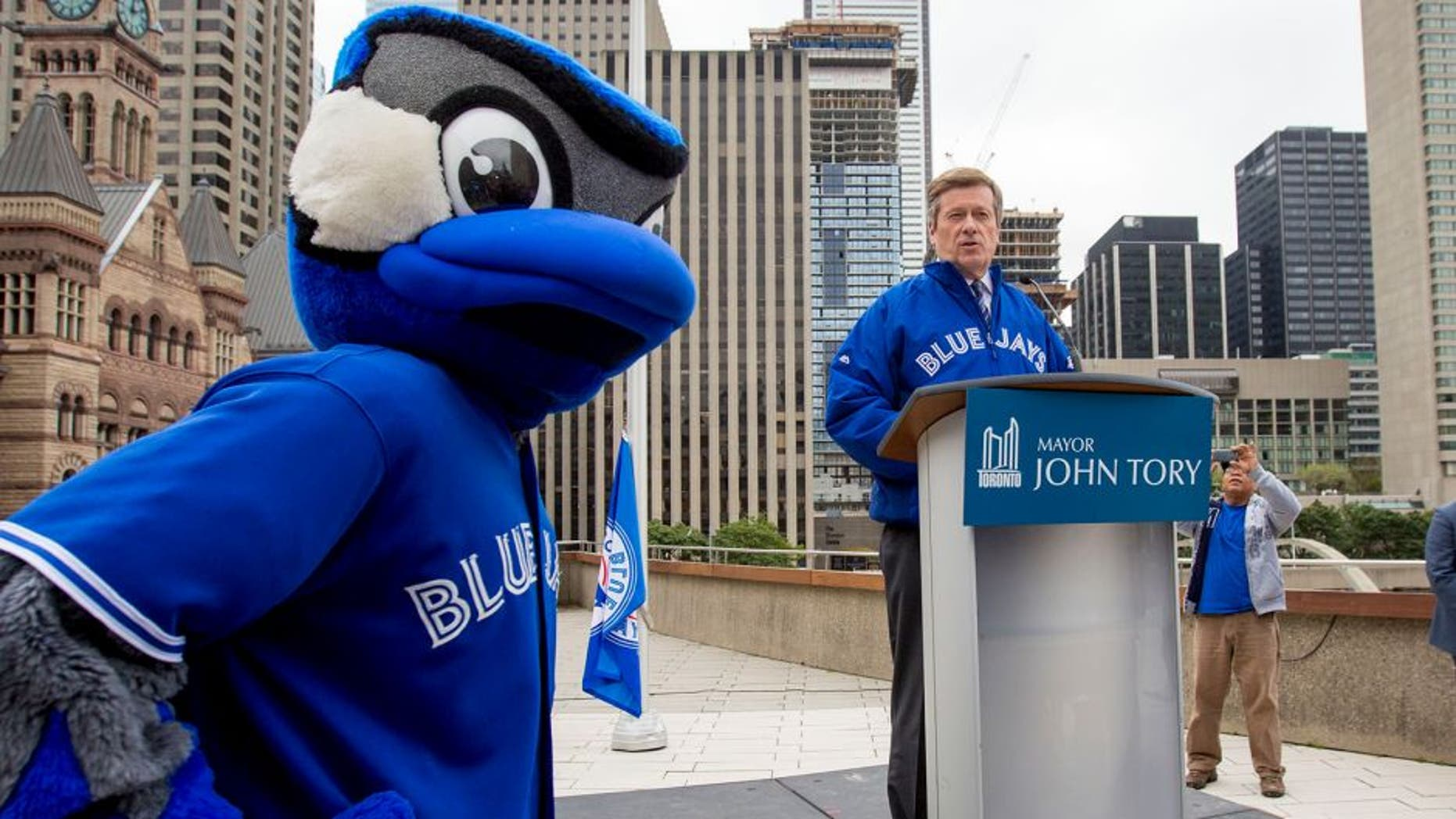 TORONTO, ON - OCTOBER 6 - Toronto Mayor John Tory held a special flag raising for the Toronto Blue Jays to kick of the 2015 post season. October 6, 2015. (Carlos Osorio/Toronto Star via Getty Images)