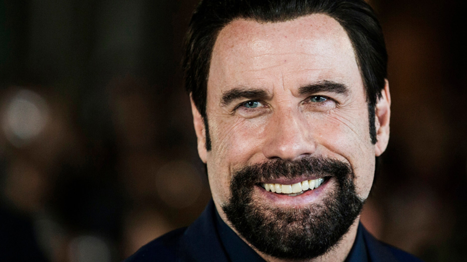 "Cast member John Travolta arrives for the ""The Forger"" gala during the Toronto International Film Festival (TIFF) in Toronto, September 12, 2014."