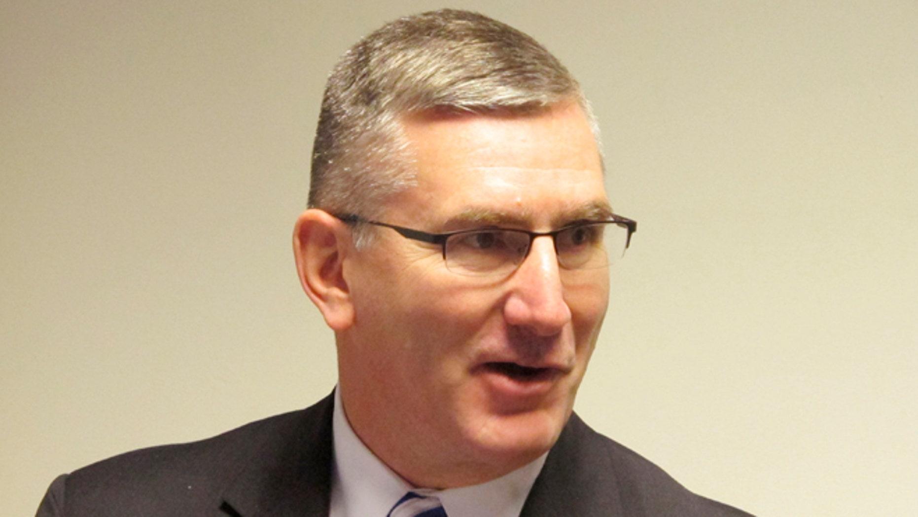 In this Jan. 26, 2014 file photo U.S. Sen. John Walsh speaks to reporters in Helena, Mont.