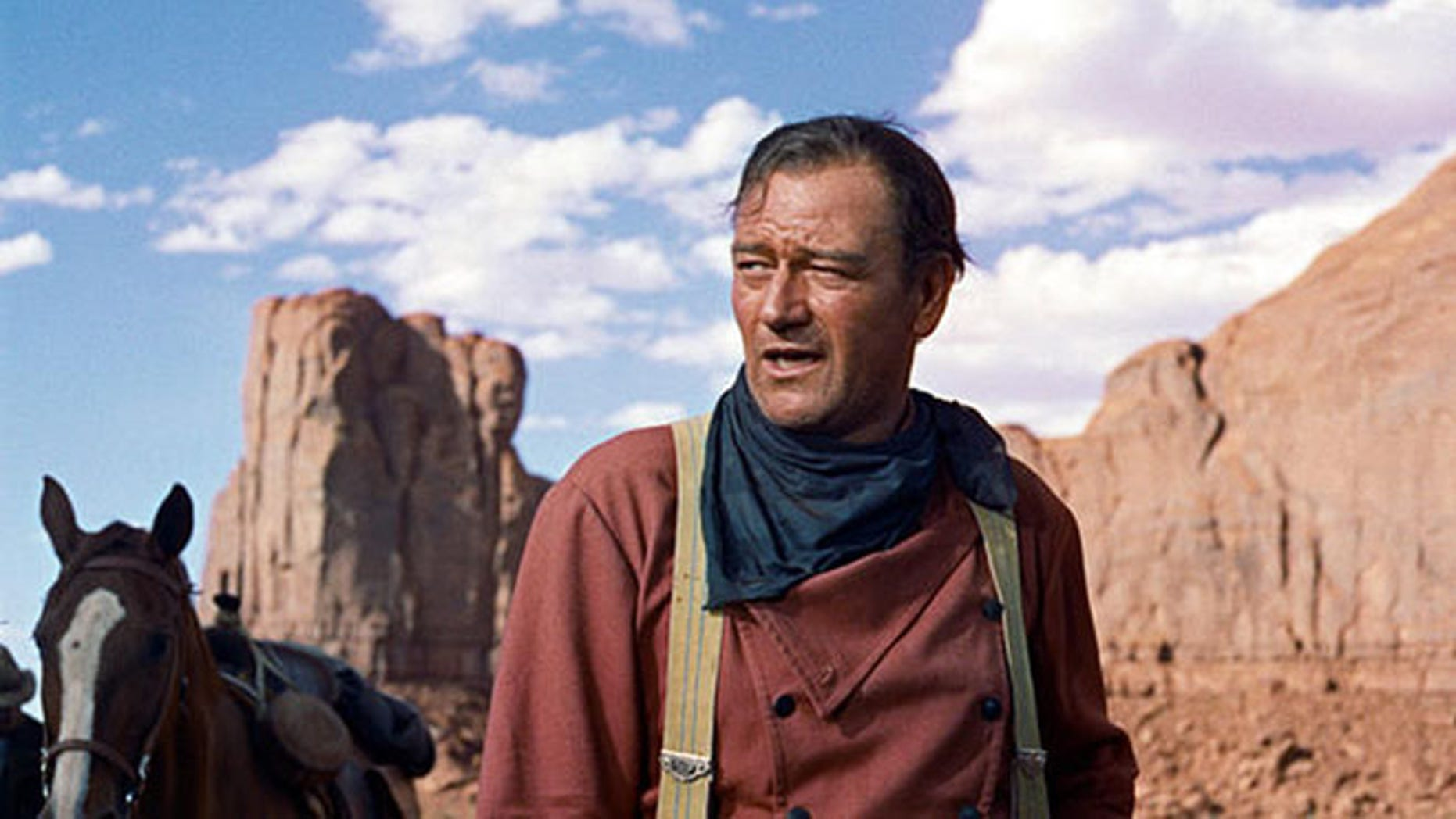 "In this photo released by Warner Bros., actor John Wayne plays Ethan Edwards in the 1956 film ""The Searchers."" The film is among the American Film Institute's best western movies."