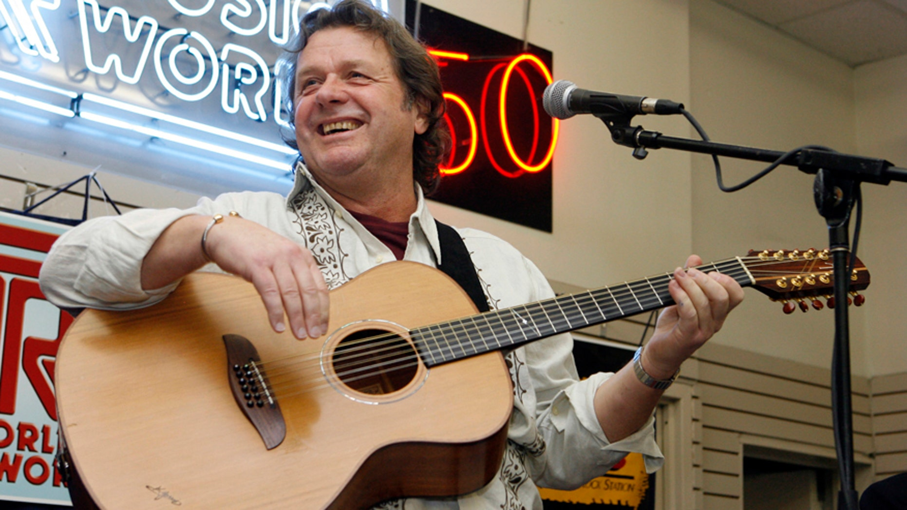 In this Thursday, April 17, 2008 file photo, John Wetton performs with the band Asia at a music store in New York.