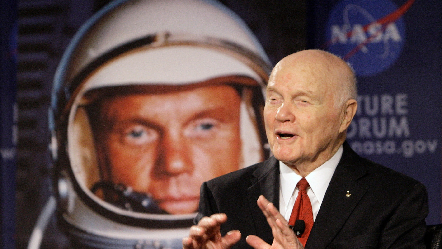 """FILE - In this Feb. 20, 2012, file photo, U.S. Sen. John Glenn talks with astronauts on the International Space Station via satellite before a discussion titled """"Learning from the Past to Innovate for the Future"""" in Columbus, Ohio.  (AP Photo/Jay LaPrete, File)"""