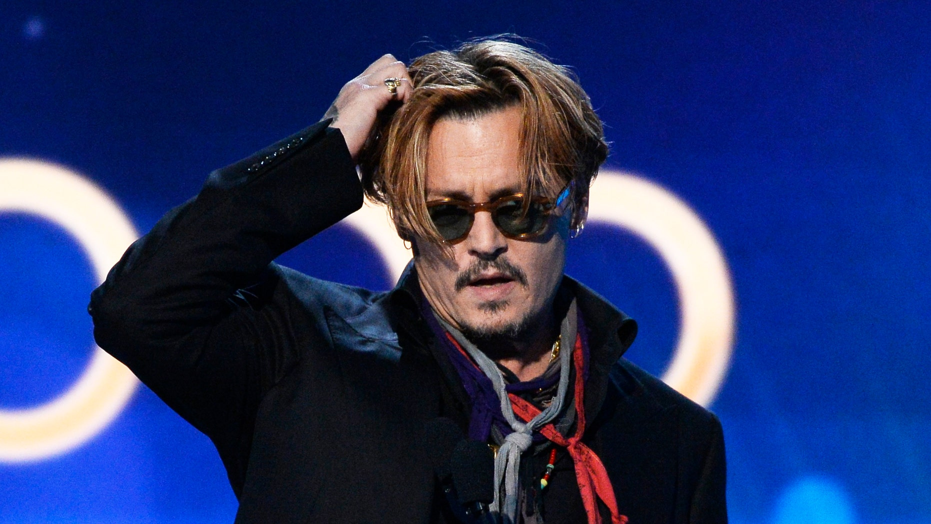 "November 14, 2014. Johnny Depp presents the Hollywood Documentary Award to ""Supermensch: The Legend of Shep Gordon"" during the Hollywood Film Awards in Hollywood, California."