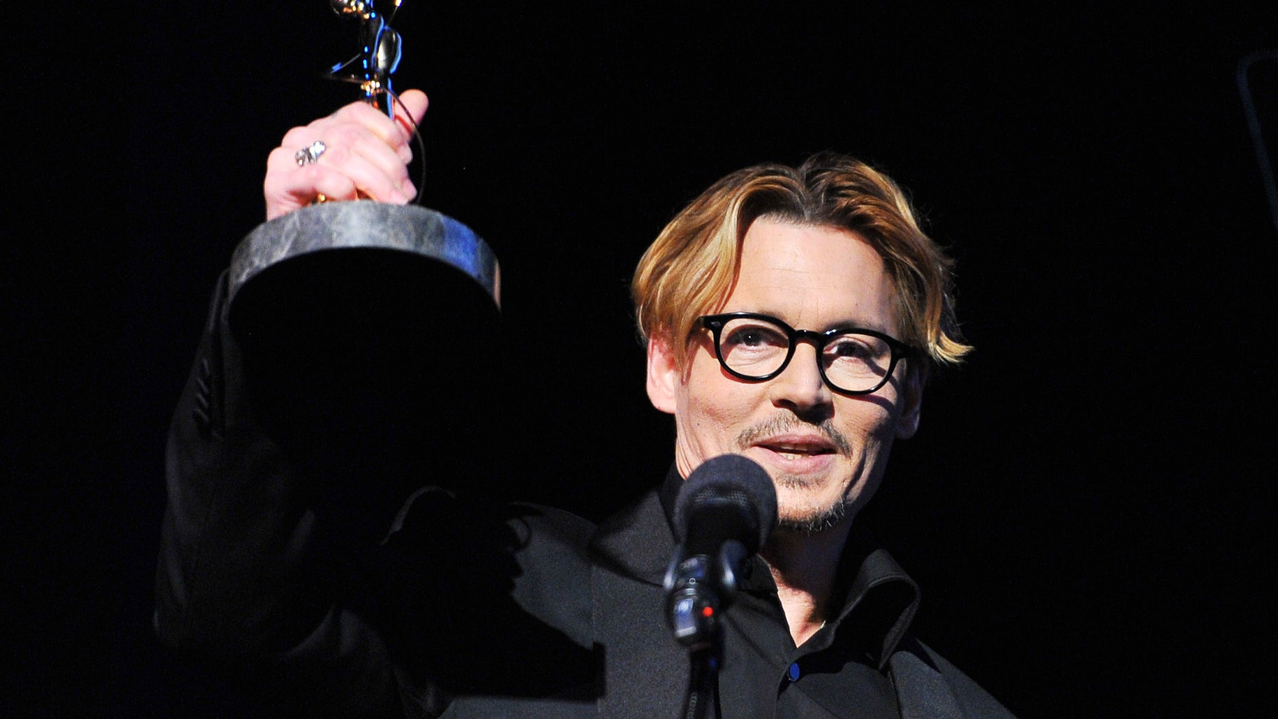 Feb. 15, 2014. Johnny Depp accepts the Distinguished Artisan Award at The Make-Up Artists and Hair Stylists Guild Awards at Paramount Studios in Los Angeles, California.