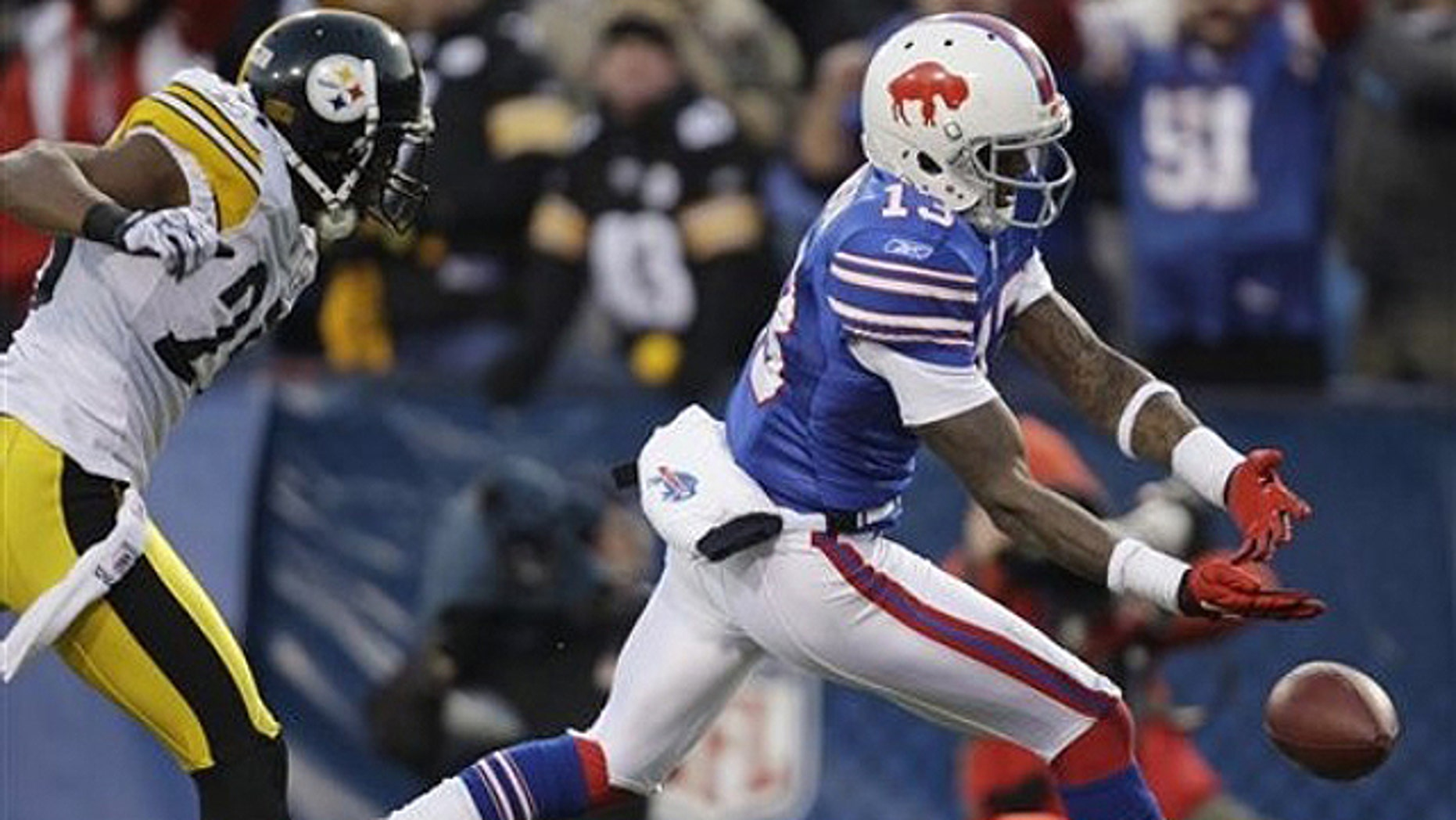 Nov. 28: Buffalo Bills' Steve Johnson (13) drops a pass in the endzone in overtime under pressure from Pittsburgh Steelers' Ryan Clark (25) during an NFL football game in Orchard Park, N.Y. The Steelers won 19-16 in overtime.  (AP)