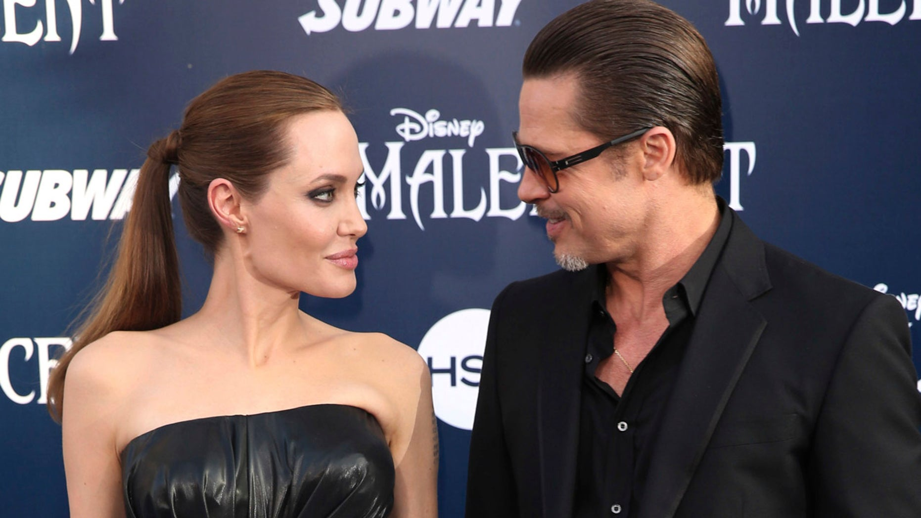 """May 28, 2014: Angelina Jolie and Brad Pitt arrive at the world premiere of """"Maleficent"""" in Los Angeles."""