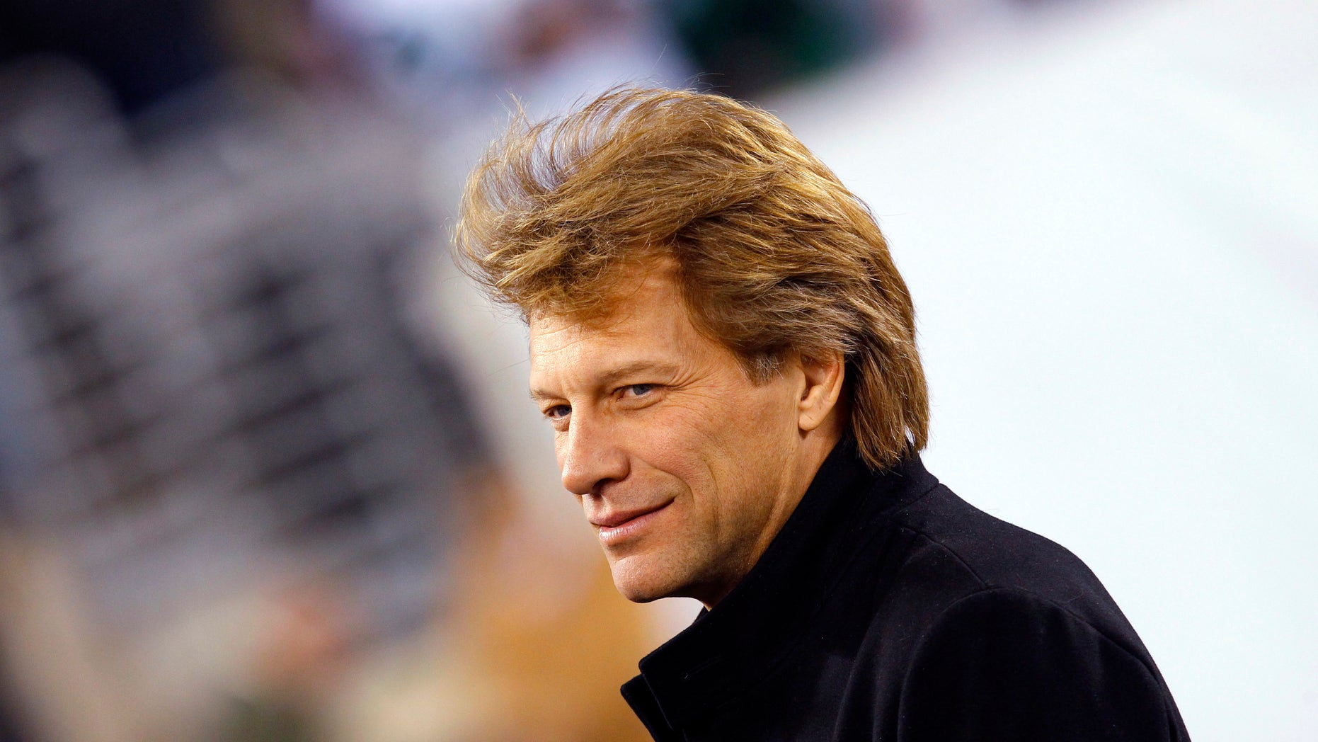 November 13, 2011. Musician Jon Bon Jovi walks on the field before the NFL football game between the New England Patriots and the New York Jets in East Rutherford, New Jersey.