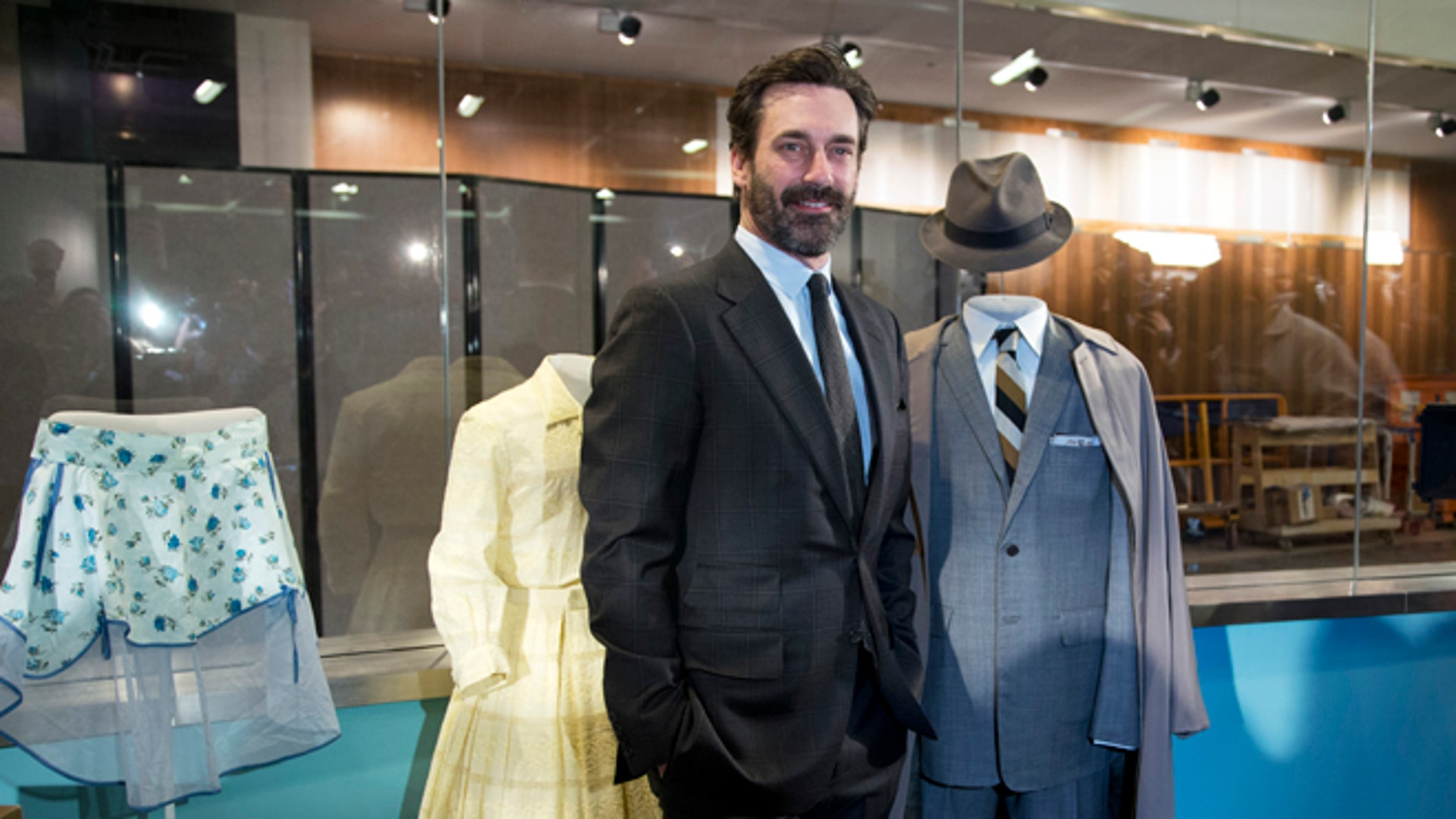 """March 27, 2015. """"Mad Men"""" cast member Jon Hamm who played Donald Draper, poses beside Don's charcoal grey suit and some objects that were donated to the National Museum of American History."""