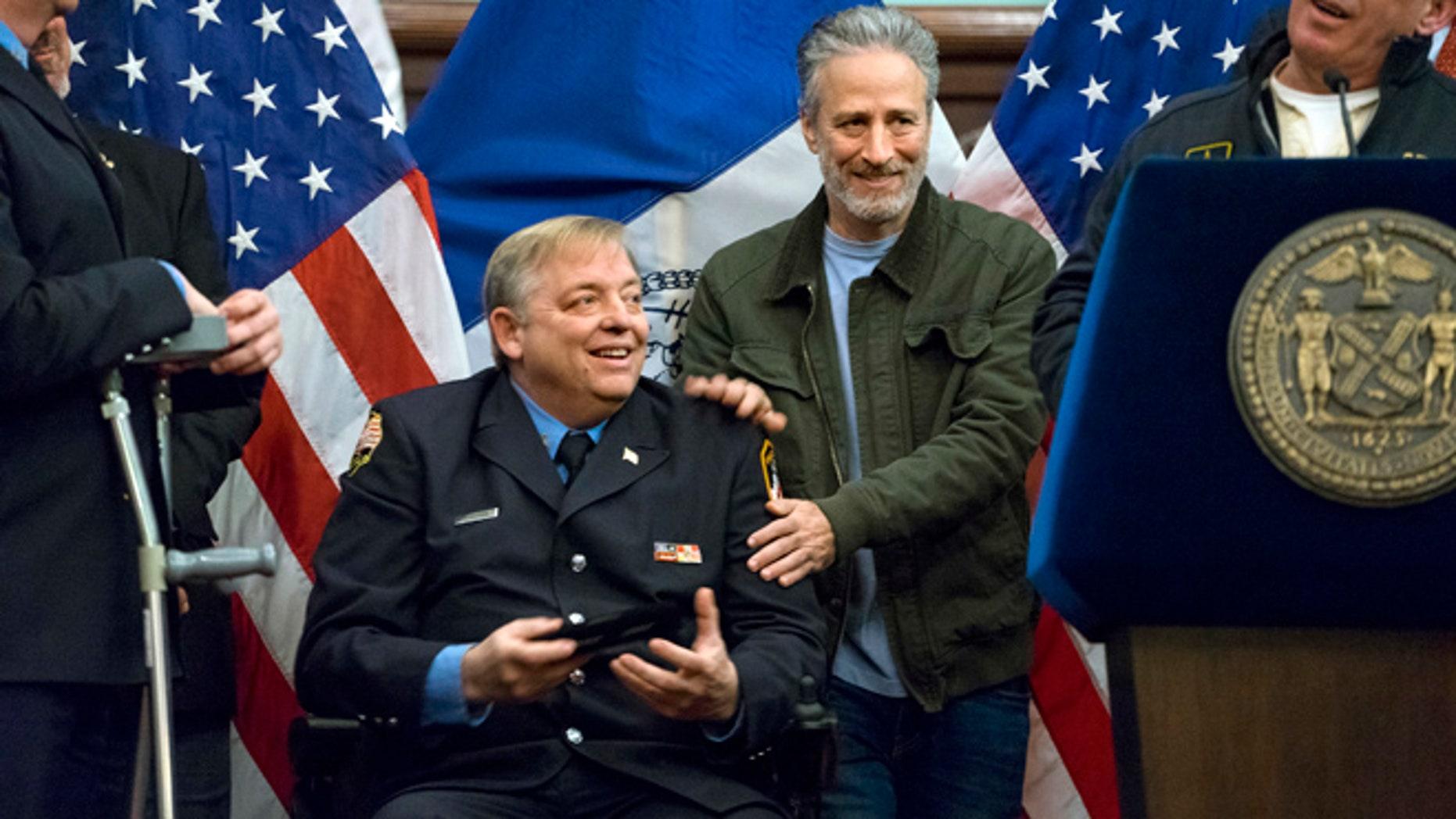 Jon Stewart and retired firefighter Ray Pfeifer in 2016. Stewart spoke at Pfeifer's funeral.