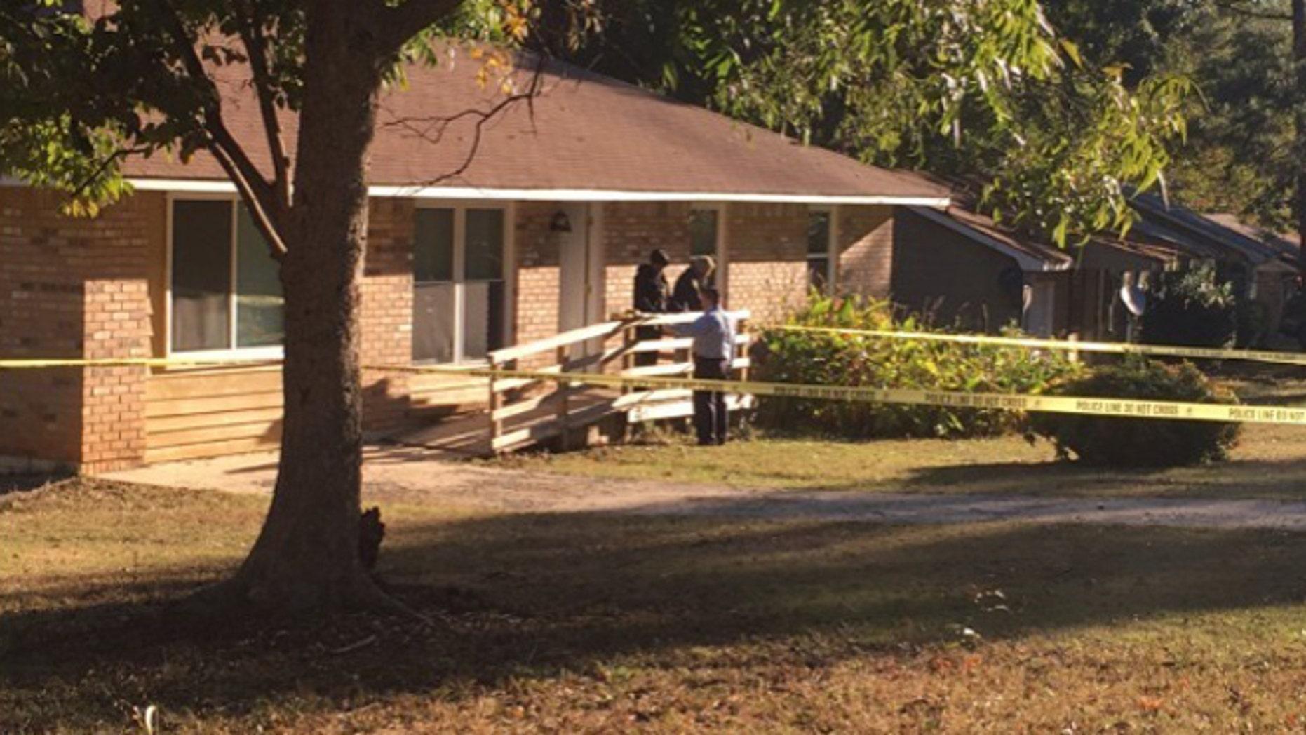 Police outside a home in Jonesboro, Georgia, where two children were shot and killed by an intruder. (Fox 5 Atlanta)