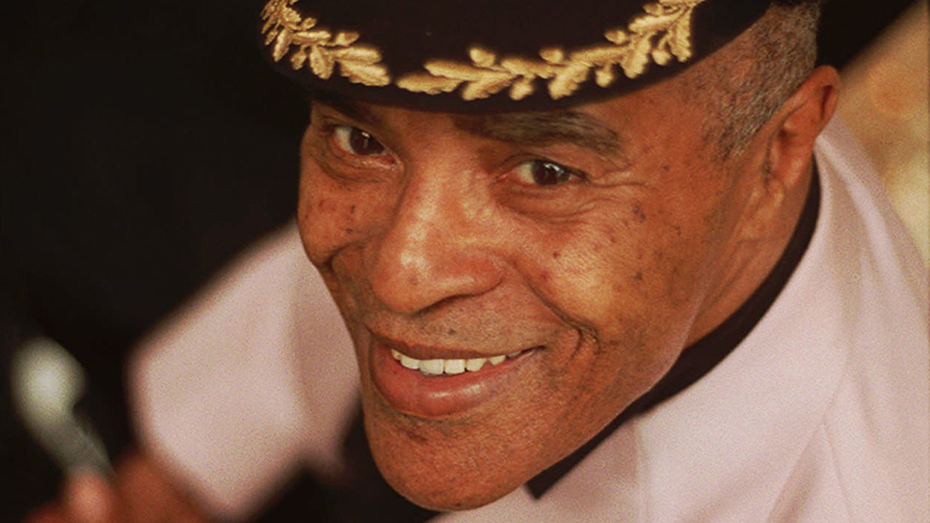 In the file photo above, jazz singer Jon Hendricks sports a favorite cap at his New York home in late May 1997. Hendricks passed away Wednesday at a hospital in Manhattan, N.Y., according to a report from The New York Times.