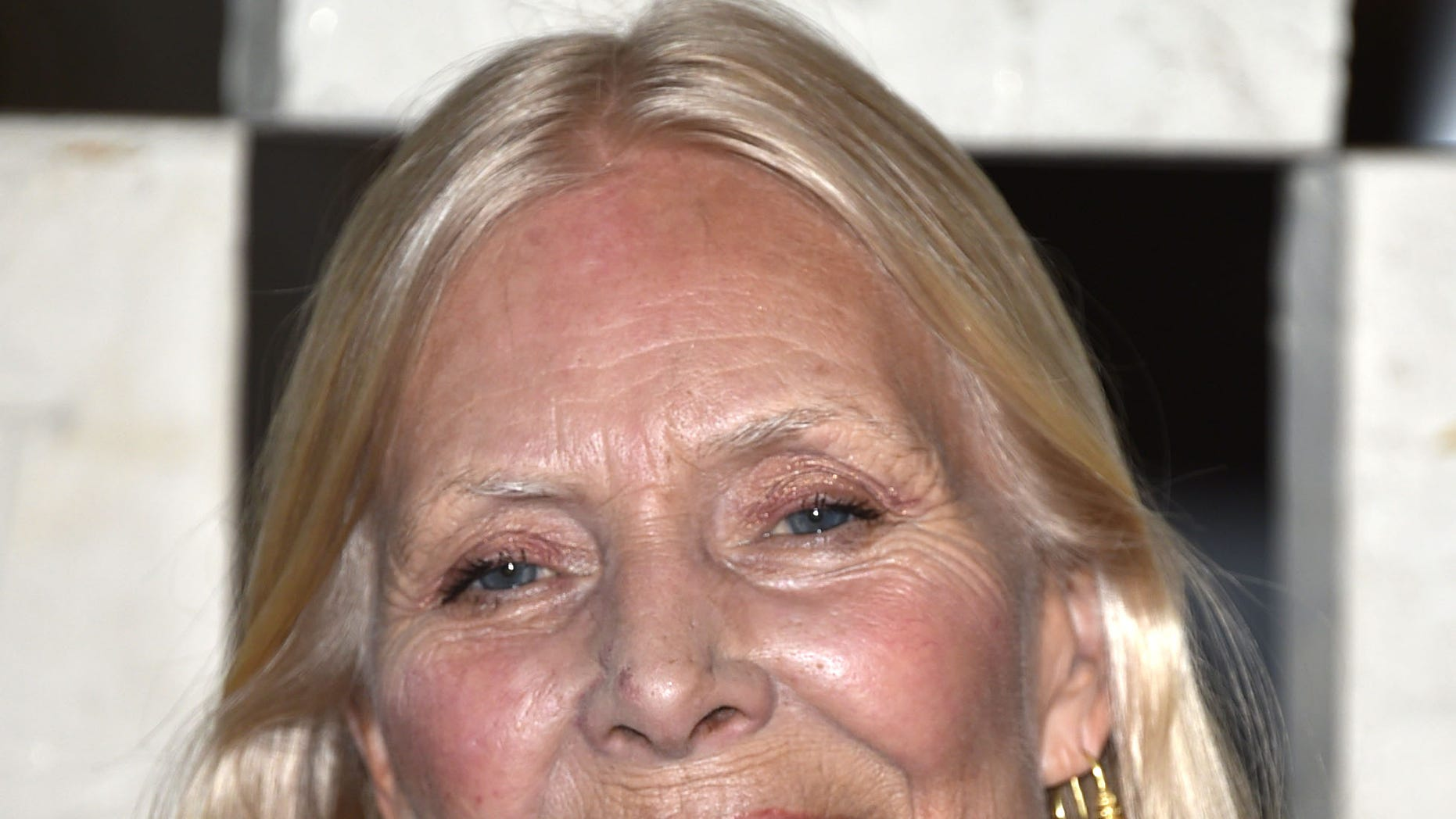 """October 11, 2014. Joni Mitchell arrives to the Hammer Museum's """"Gala In The Garden"""" in Los Angeles."""