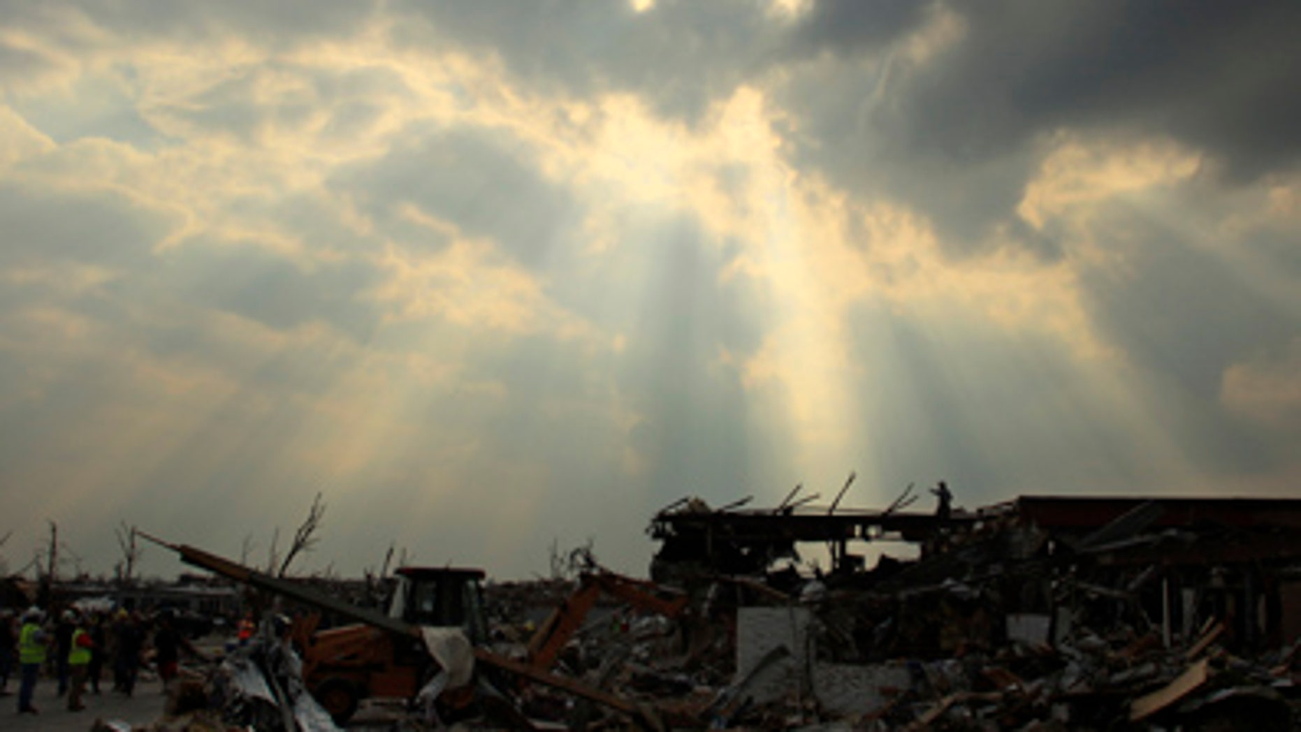 May 28: A search and rescue team surveys the area from atop the rubble of a destroyed building in Joplin, Mo. An EF-5 tornado tore through much of the city Sunday, damaging a hospital and hundreds of homes and businesses and killing at least 139 people. (AP)