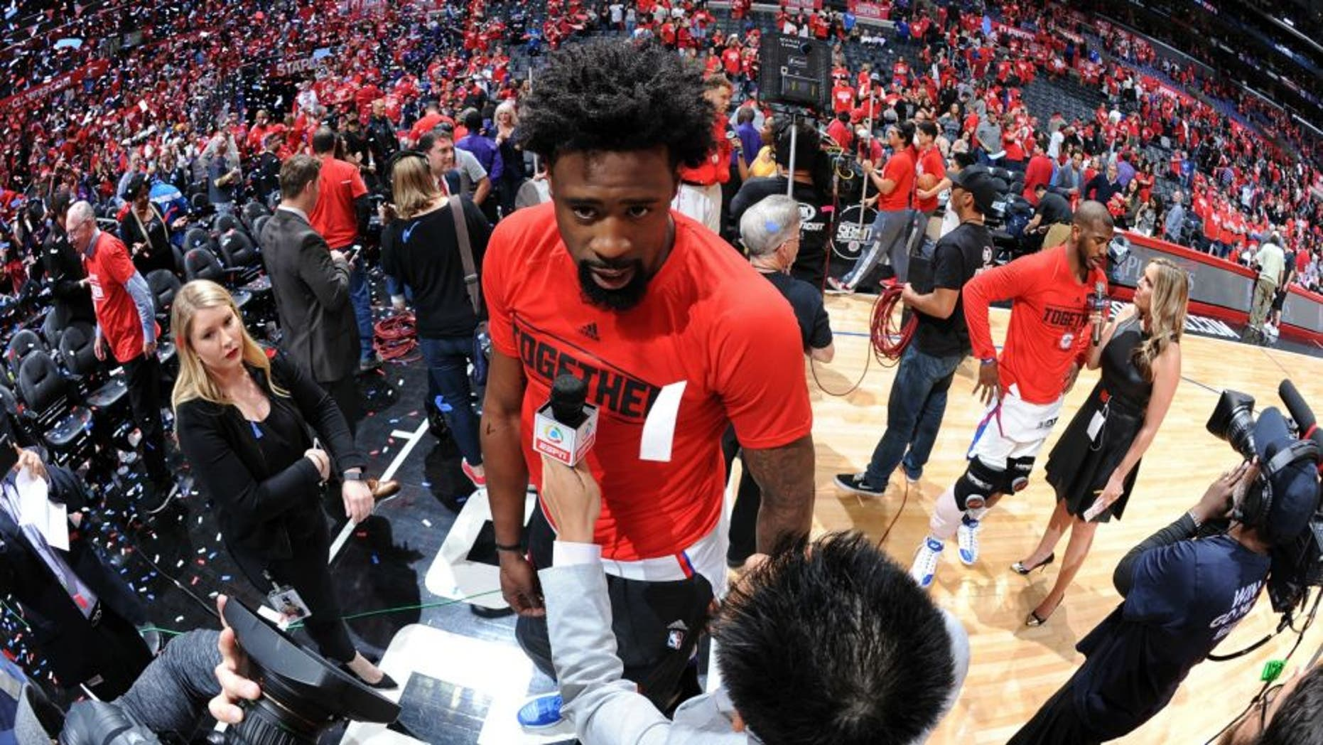 LOS ANGELES, CA - APRIL 17: DeAndre Jordan #6 of the Los Angeles Clippers is interviewed after the game against the Portland Trail Blazers in Game One of the Western Conference Quarterfinals during the 2016 NBA Playoffs on April 17, 2016 at STAPLES Center in Los Angeles, California. NOTE TO USER: User expressly acknowledges and agrees that, by downloading and/or using this Photograph, user is consenting to the terms and conditions of the Getty Images License Agreement. Mandatory Copyright Notice: Copyright 2016 NBAE (Photo by Andrew D. Bernstein/NBAE via Getty Images)